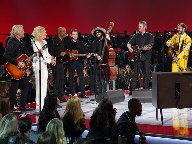 "Post Malone, right, wears a Jerry Lee Atwood suit in this promotional photo for NBC's ""Elvis All-Star Tribute,"" set to air Feb. 17. Also pictured, from left, Little Big Town members Philip Sweet and Kimberly Schlapman, Darius Rucker, Mac Davis, Don Was and Blake Shelton."