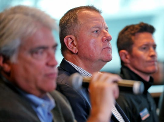 IndyCar President Jay Frye, center, listens during a press conference on the IndyCar announcement of their TV schedule, during a press conference at Indianapolis Motor Speedway, Wednesday, Jan. 9, 2019.