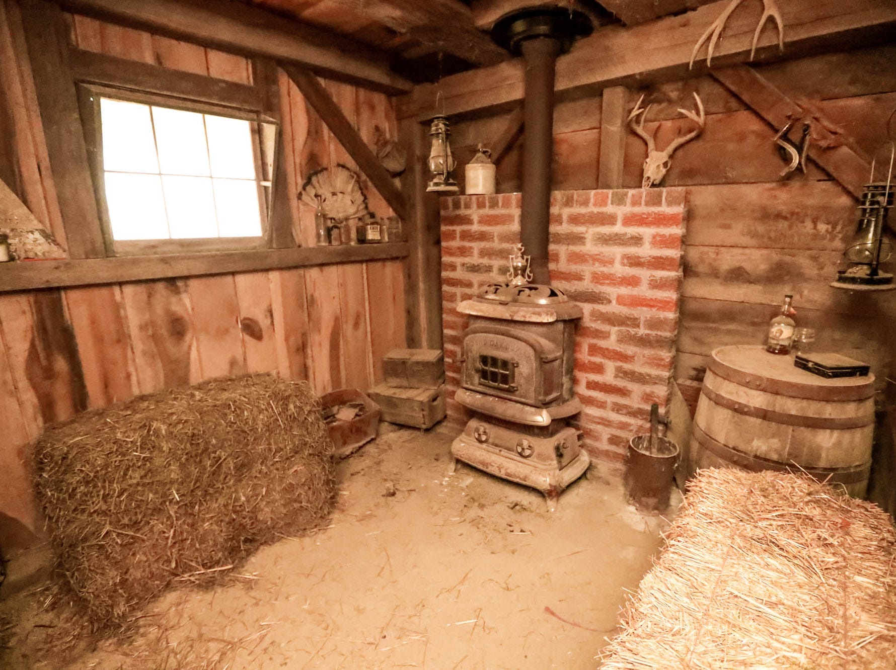 A man cave with a vintage stove is located inside a one-hundred-year-old barn moved from northern Indiana, which sits behind a traditional style $2m home up for sale in Bargersville Ind. on Wednesday, Jan. 9, 2019. The house and barn sit on 8.1 acres.
