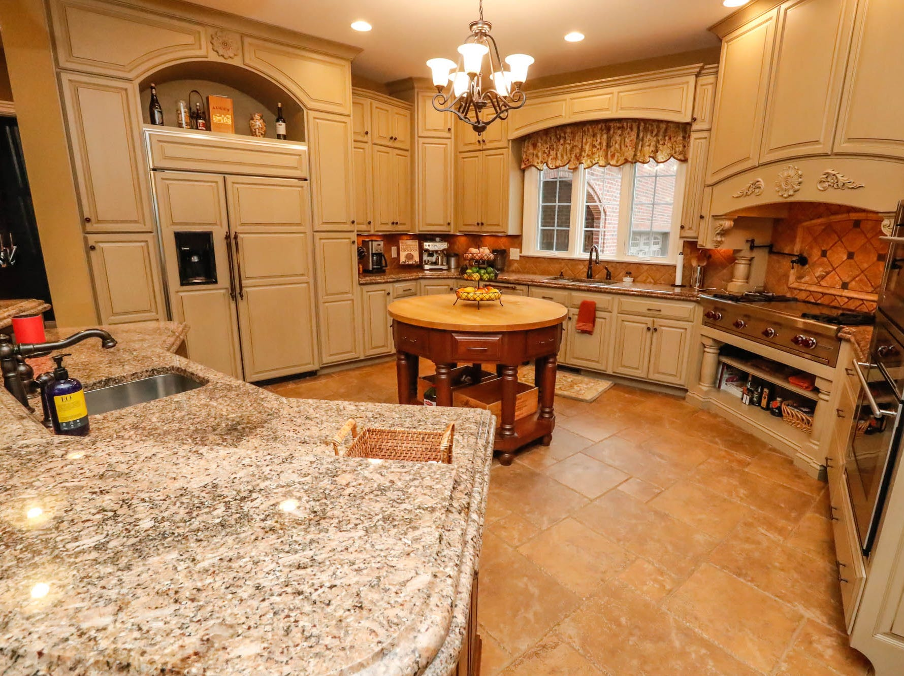 The open plan kitchen features granite counter tops and rustic Tuscan tile in a traditional $2m home up for sale in Bargersville Ind. on Wednesday, Jan. 9, 2019. The house sits on 8.1 acres.