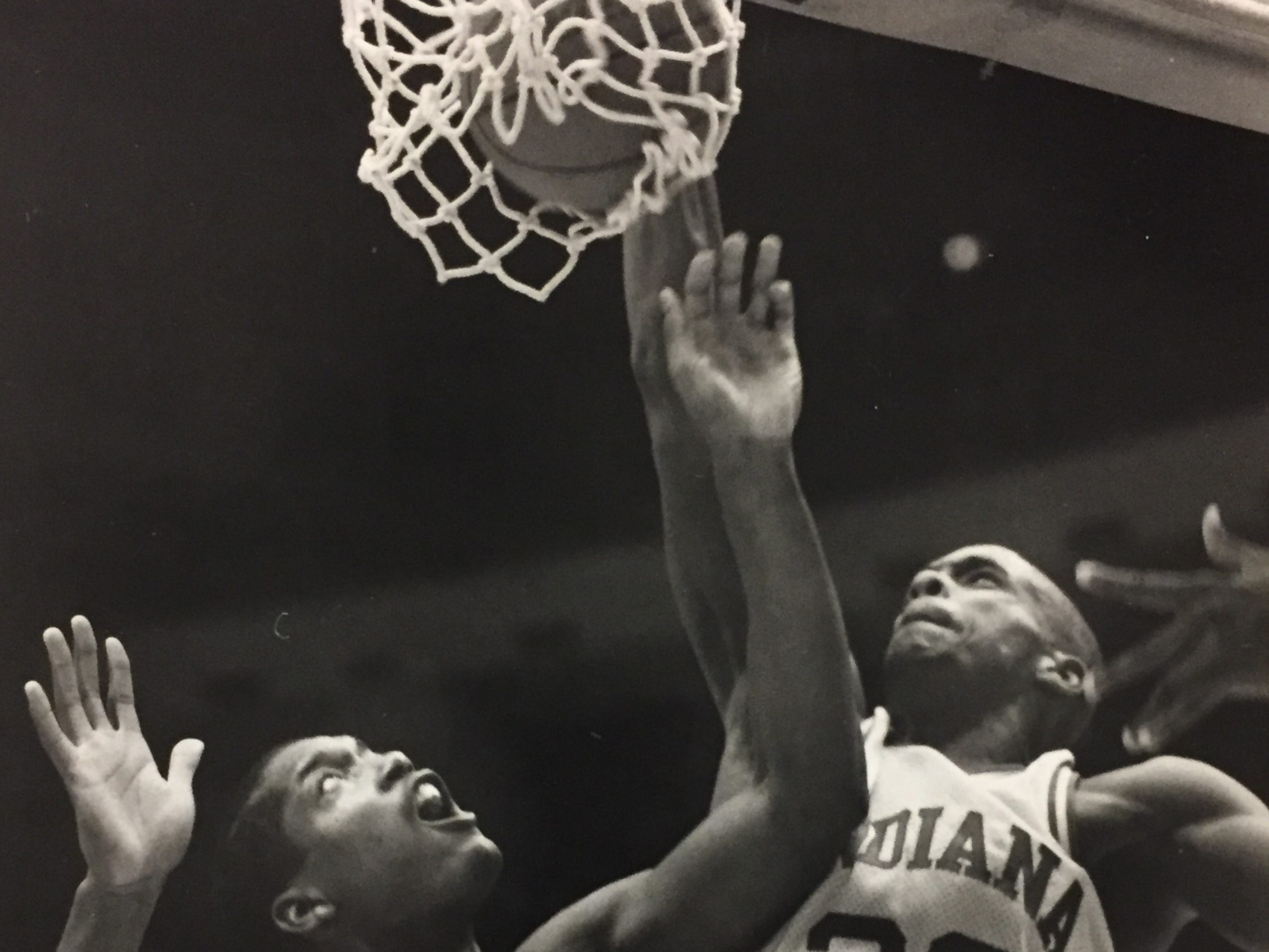 Dean Garrett throws down a dunk over Purdue's Melvin McCants on Jan. 30, 1988.