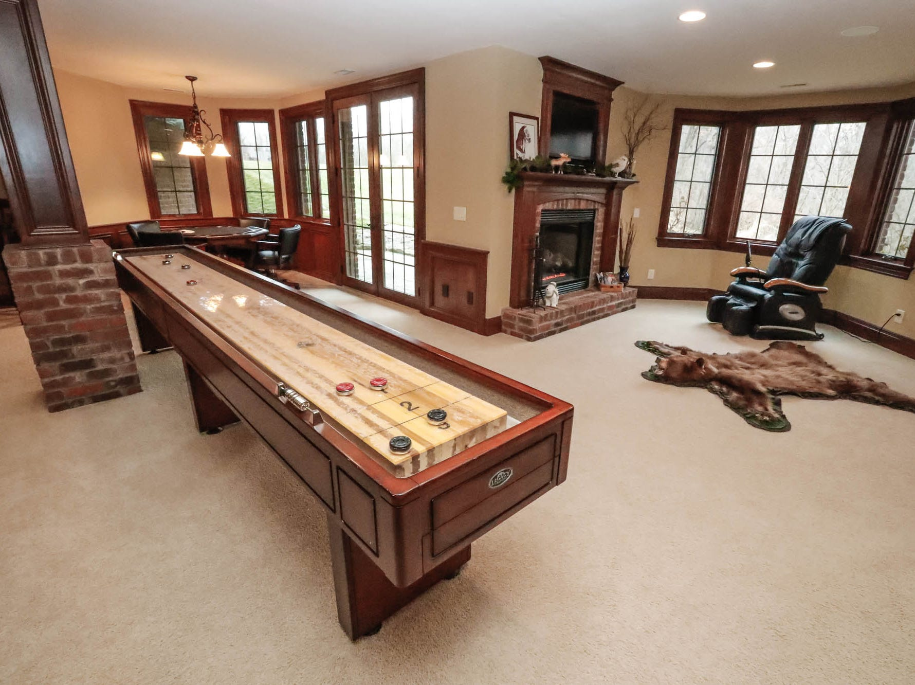 The basement of a traditional $2m home up for sale in Bargersville Ind., features a shuffleboard table, aquarium, bar, fireplace and home theatre room on Wednesday, Jan. 9, 2019. The home sits on 8.1 acres.