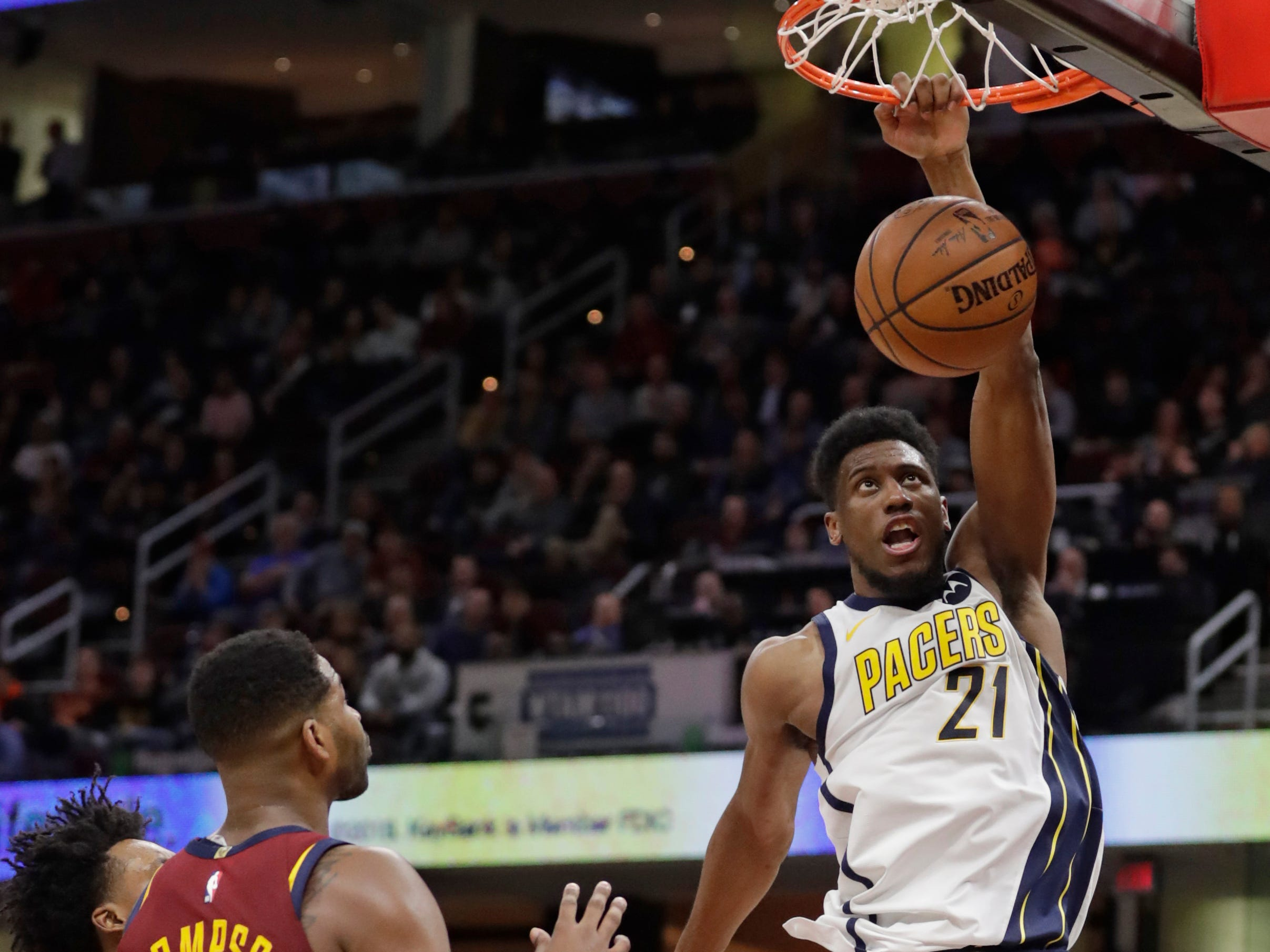 Indiana Pacers' Thaddeus Young dunks against the Cleveland Cavaliers during the first half of an NBA basketball game Tuesday, Jan. 8, 2019, in Cleveland.