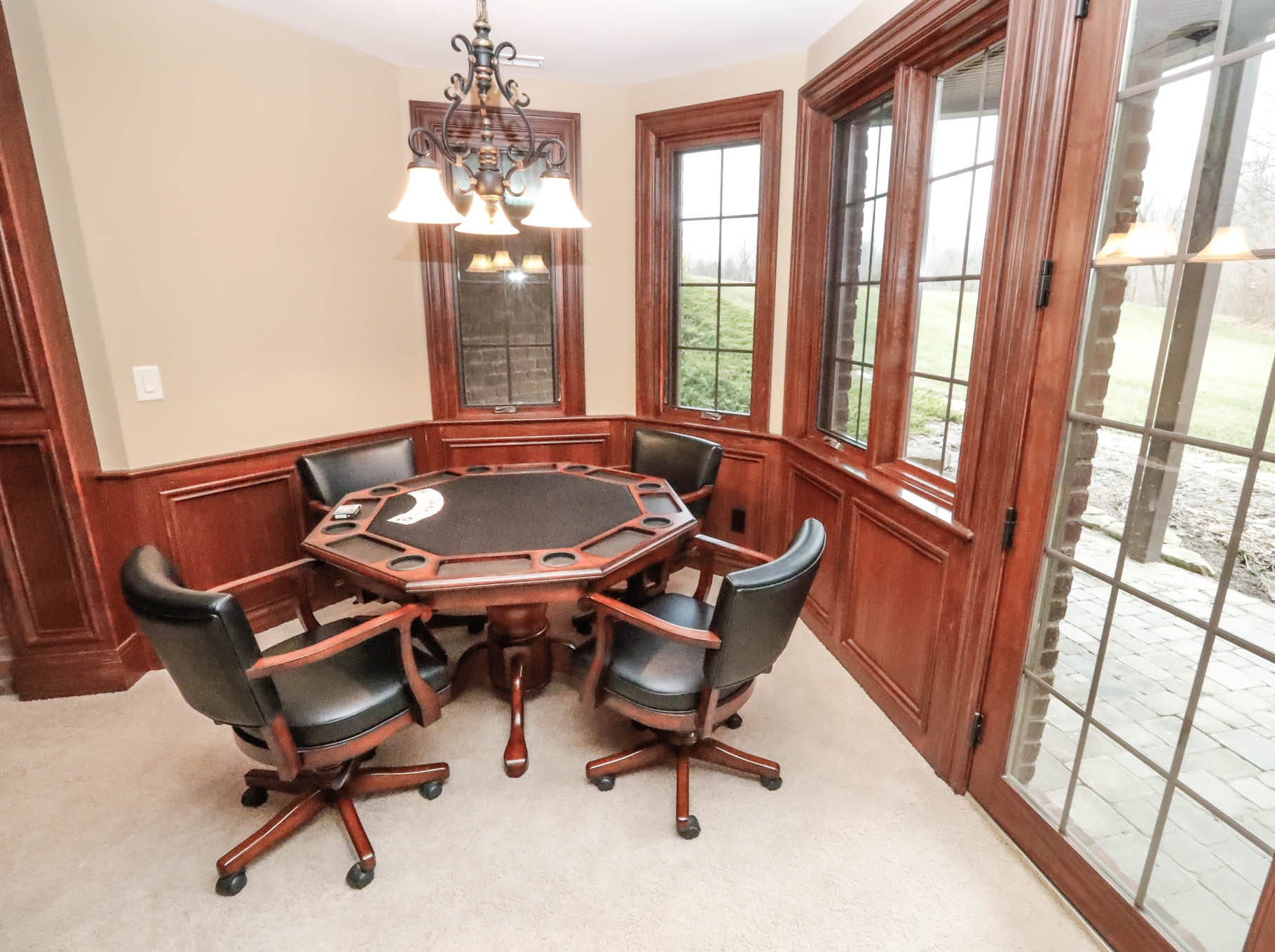 The basement of a traditional $2m home up for sale in Bargersville Ind., features a game table, shuffleboard table, aquarium, bar, fireplace and home theatre room on Wednesday, Jan. 9, 2019. The home sits on 8.1 acres.