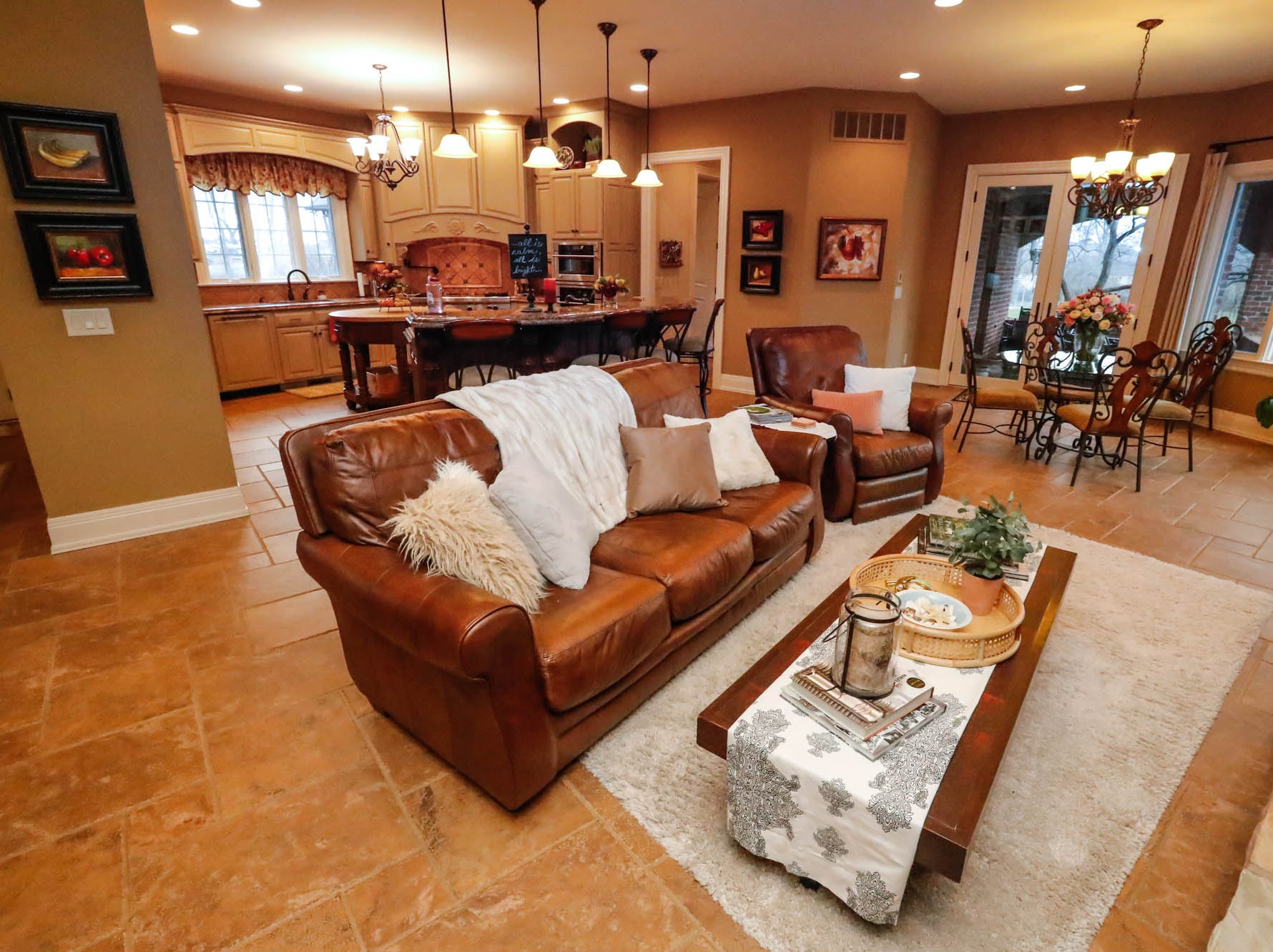 The kitchen and living room feature an open floor plan in a traditional $2m home with elements of French country and Tuscan influence up for sale in Bargersville Ind. on Wednesday, Jan. 9, 2019. The house sits on 8.1 acres.