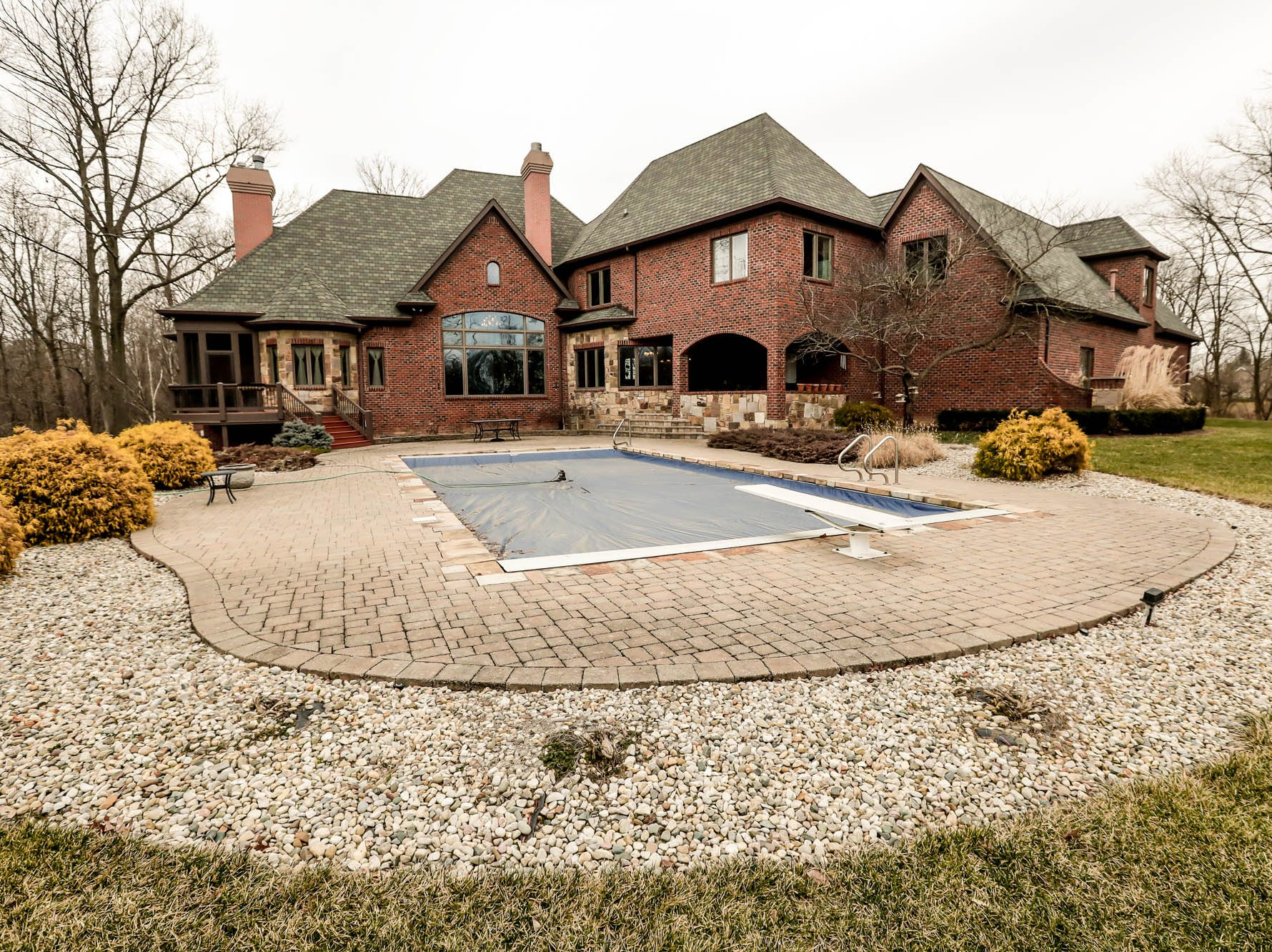 An in-ground saltwater pool sits behind a traditional style $2m home with elements of French country and Tuscan influence up for sale in Bargersville Ind. on Wednesday, Jan. 9, 2019. The house sits on 8.1 acres.