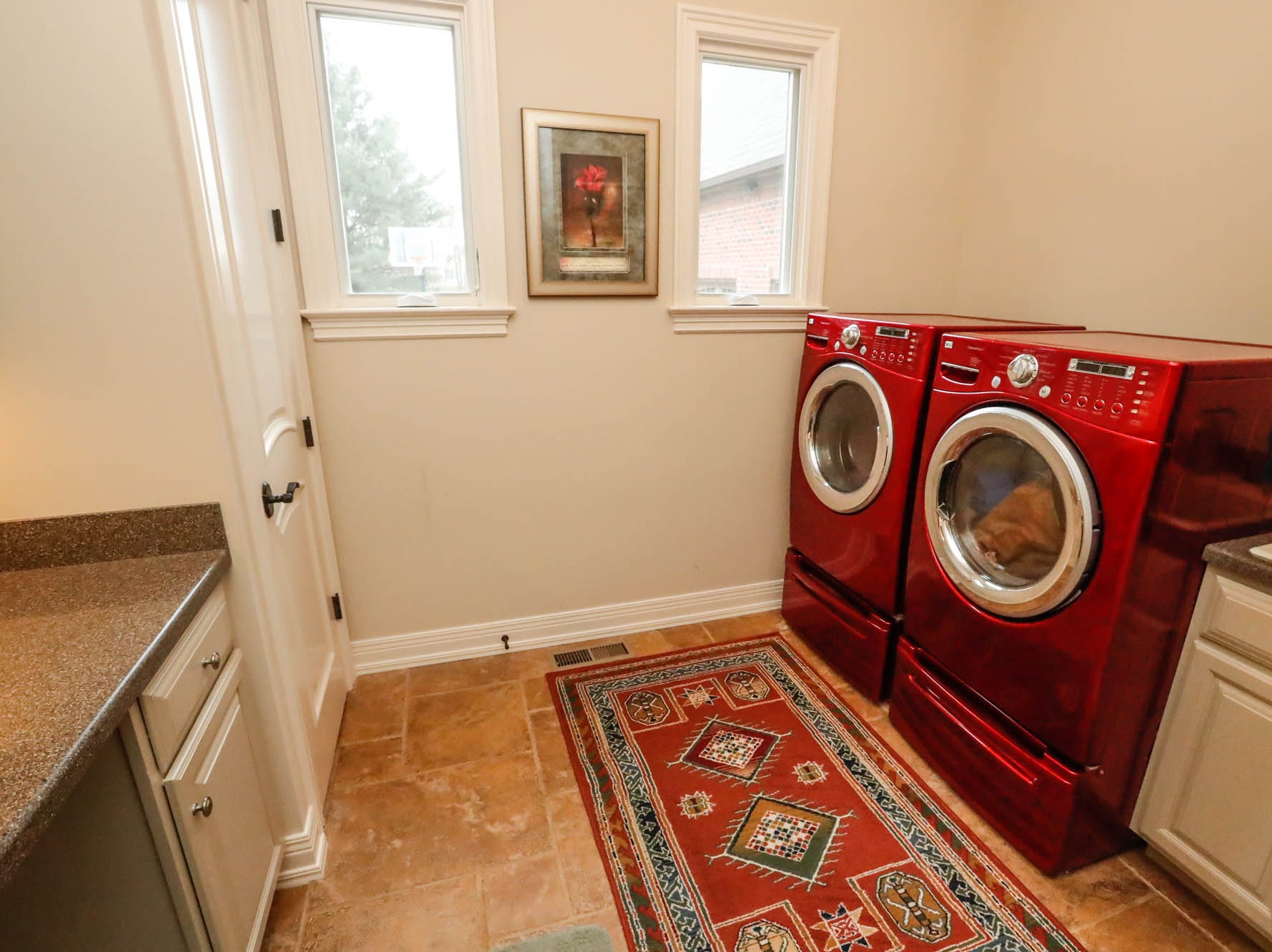 An upstairs and downstairs laundry room is featured in a traditional $2m home with elements of French country, and Tuscan influence features for sale in Bargersville Ind. on Wednesday, Jan. 9, 2019. The house sits on 8.1 acres.