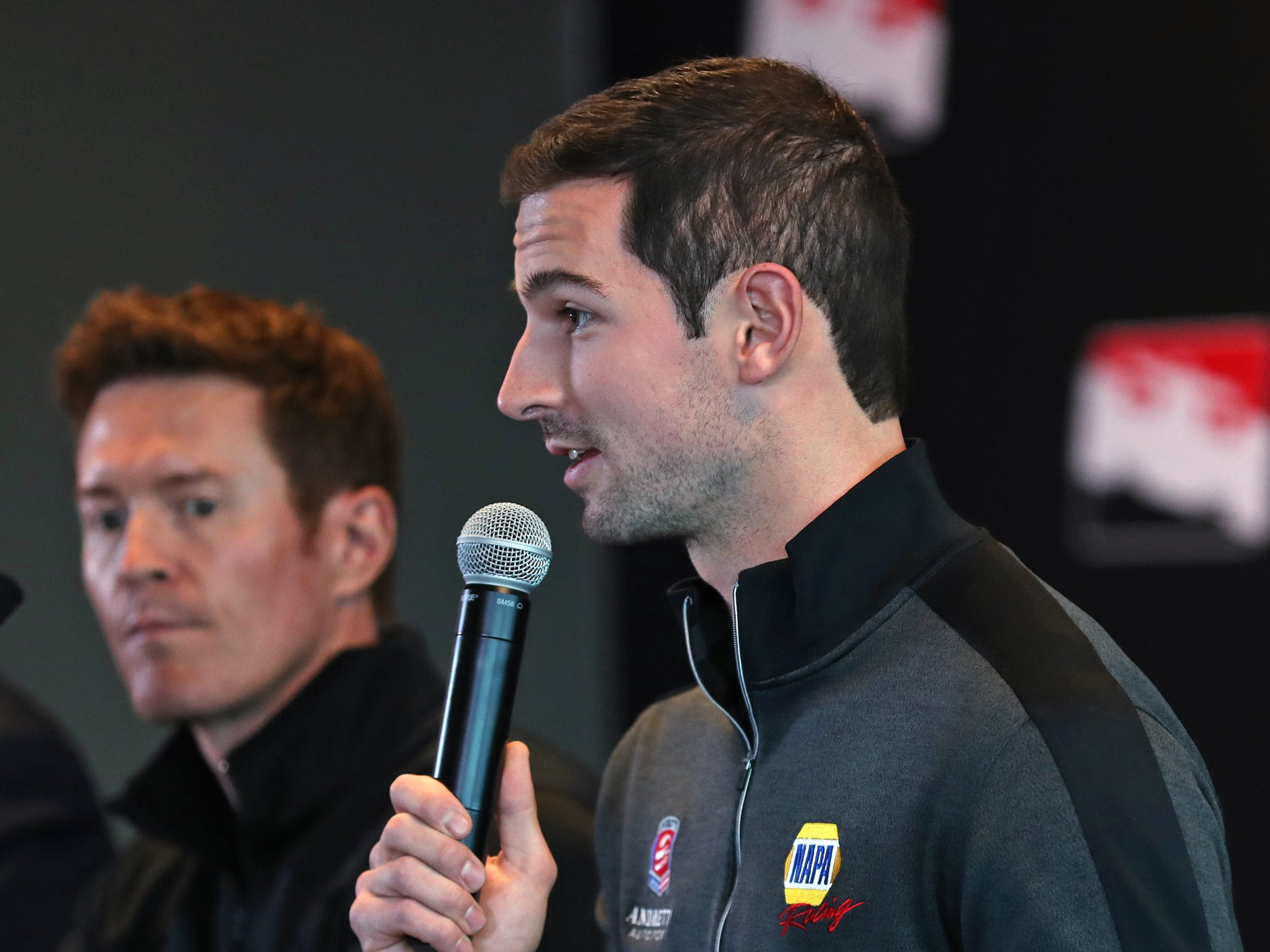 IndyCar racer Alexander Rossi talks about the upcoming season during a press conference on the IndyCar announcement of their TV schedule, during a press conference at Indianapolis Motor Speedway, Wednesday, Jan. 9, 2019.