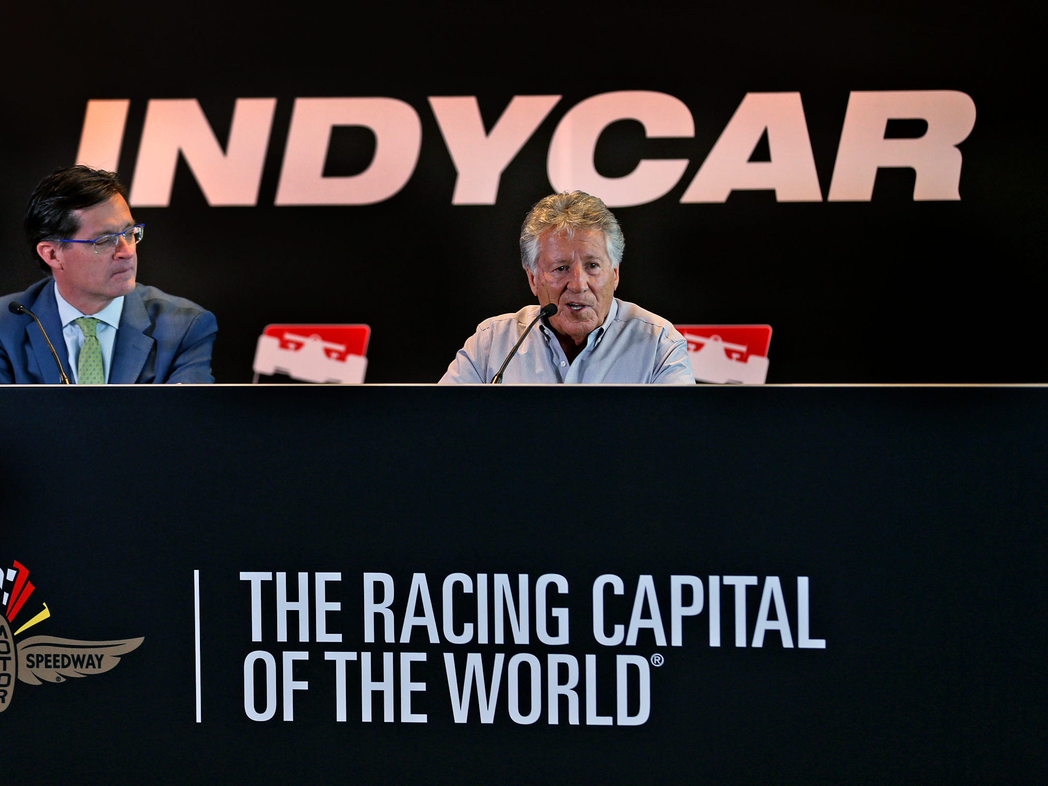 IMS President Doug Boles, left, listens as Indy 500 champion Mario Andretti during a press conference on the 50th anniversary of Mario Andretti's winning of the Indy 500, at Indianapolis Motor Speedway, Wednesday, Jan. 9, 2019.