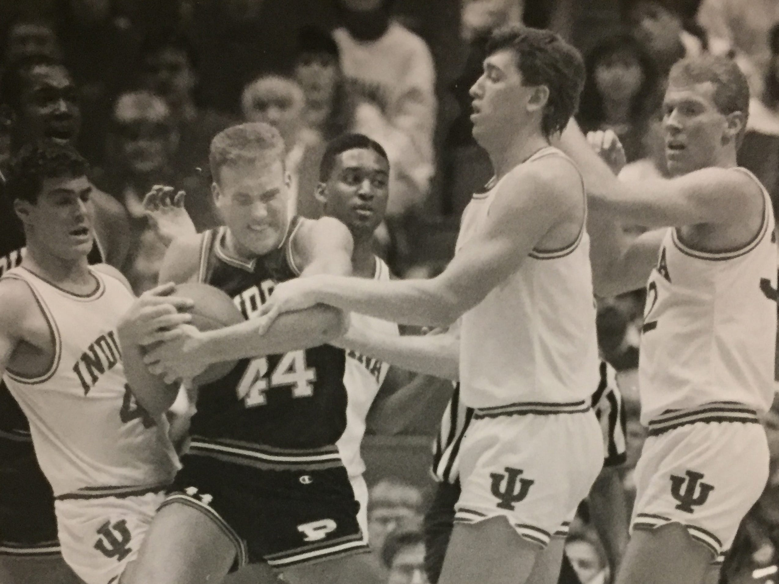 Purdue's John Brugos is guarded by four Hoosiers (left to right) Joe Hillman, Lyndon Jones, Todd Jadlow and Eric Anderson on Feb. 12, 1989.