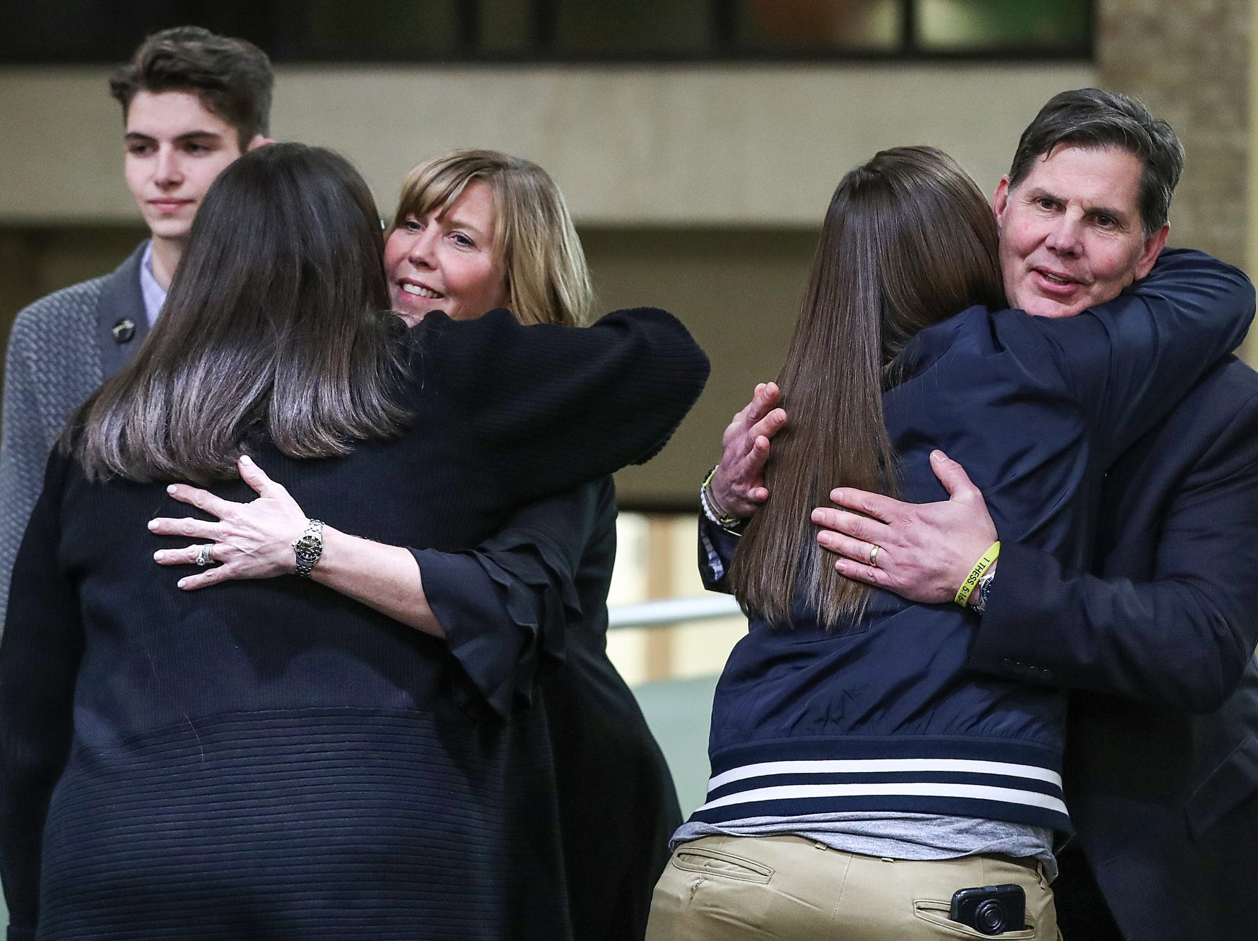 From left, Kelly and Tony Trent are hugged by well-wishers after the funeral for their son, former Purdue student and superfan Tyler Trent, at College Park Church in Indianapolis, Tuesday, Jan. 8, 2019. The 20-year-old died of a rare form of bone cancer on Jan. 1, 2019.