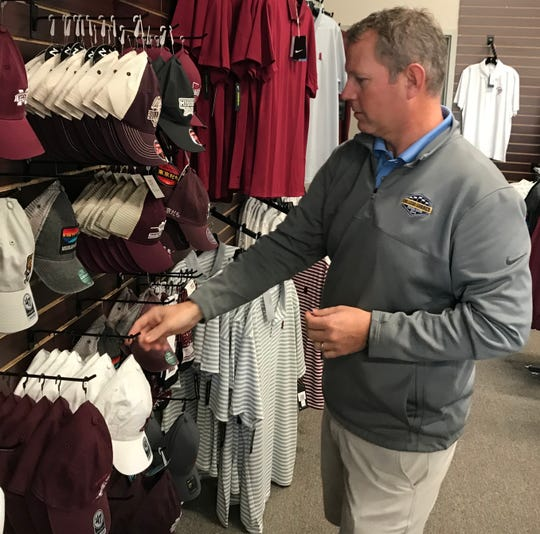 Scott Werne checks caps at The College Corner in Flowood.