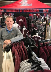 Scott Werne, owner of The College Corner in Ridgeland and Flowood, strives to offer a variety of licensed college merchandise at the stores.