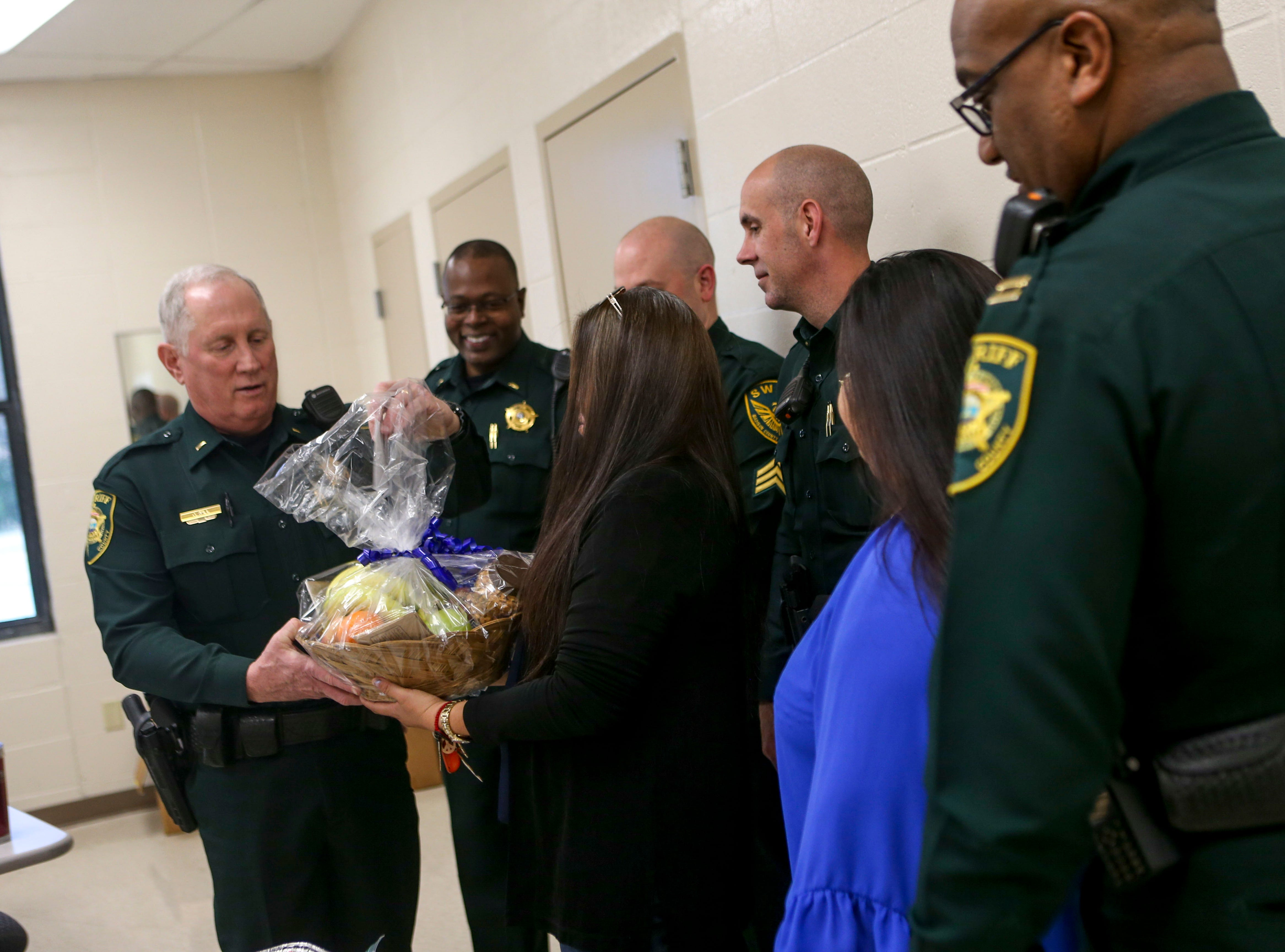 Madison County Sheriff's deputies stand for a photo with Estella Villalobos, Maria A. Vela, and Emily Crabtree after the ladies brought snacks for the deputies on National Law Enforcement Day at Madison County Sheriff's Office in Denmark, Tenn., on Wednesday, Jan. 9, 2019.