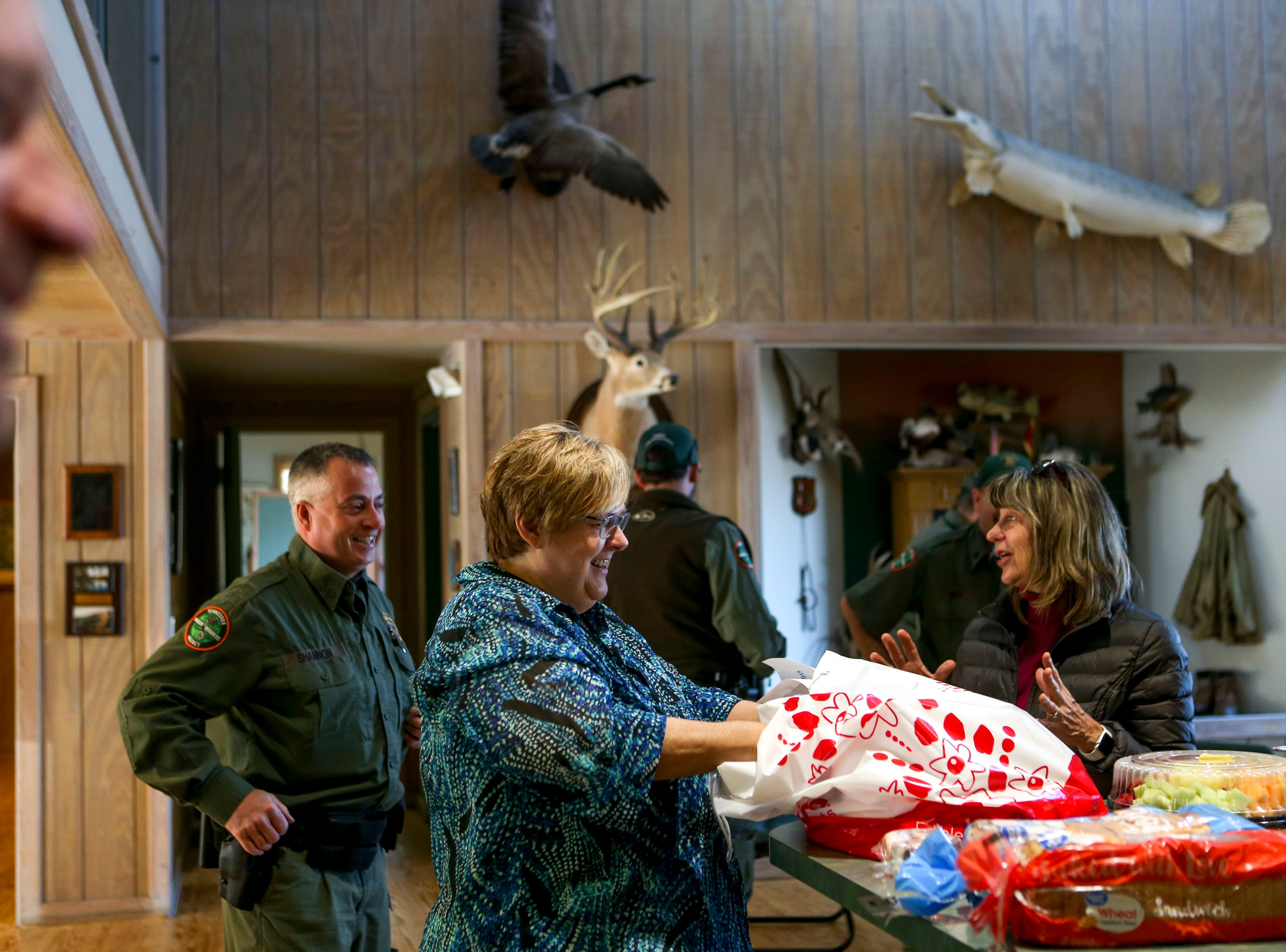 Linda Rizzuto, left, and Beverly Denton, right, drop off food for Wildlife Resource Officers on National Law Enforcement Day at the Tennessee Wildlife Resource Agency Region One offices in Jackson, Tenn., on Wednesday, Jan. 9, 2019.