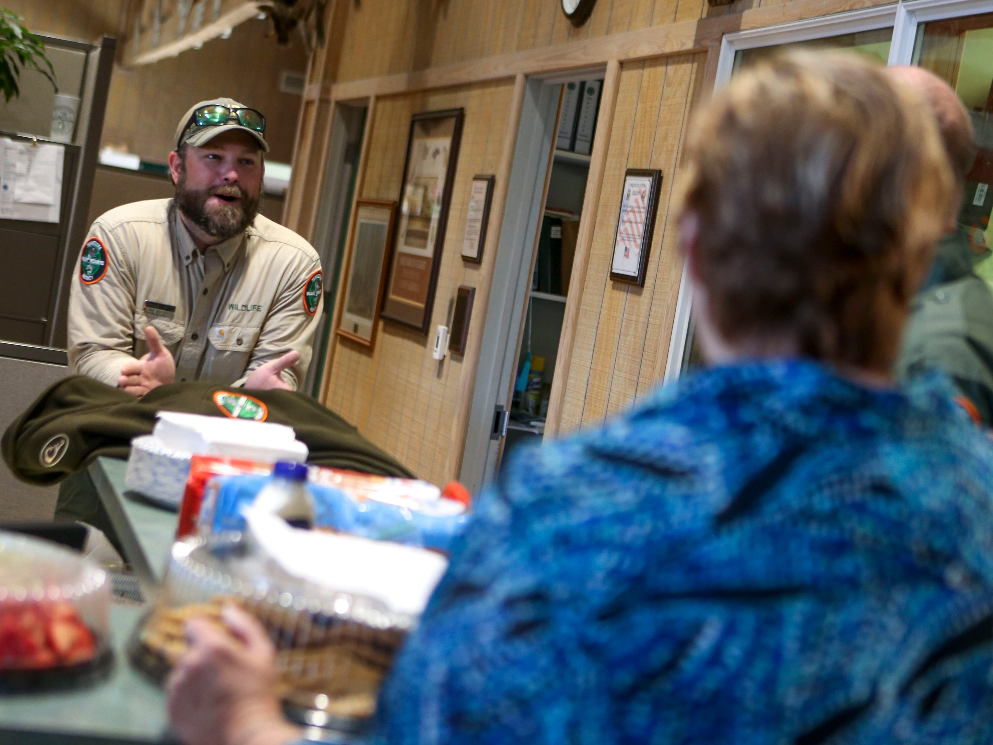 """Daniel Stanfield, the """"favorite son-in-law"""" of Linda Rizzuto, a volunteer to bring around snacks for law enforcement agencies, jokes around with Rizzuto at the Tennessee Wildlife Resource Agency Region One offices in Jackson, Tenn., on Wednesday, Jan. 9, 2019."""