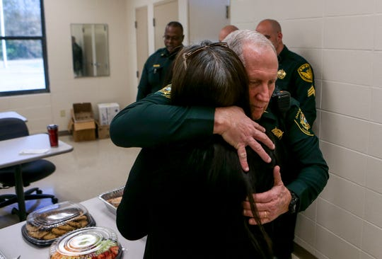 Lt Joe Gill embraces Maria A. Vela and thanks her for visiting the deputies on National Law Enforcement Day at Madison County Sheriff's Office in Denmark, Tenn., on Wednesday, Jan. 9, 2019.