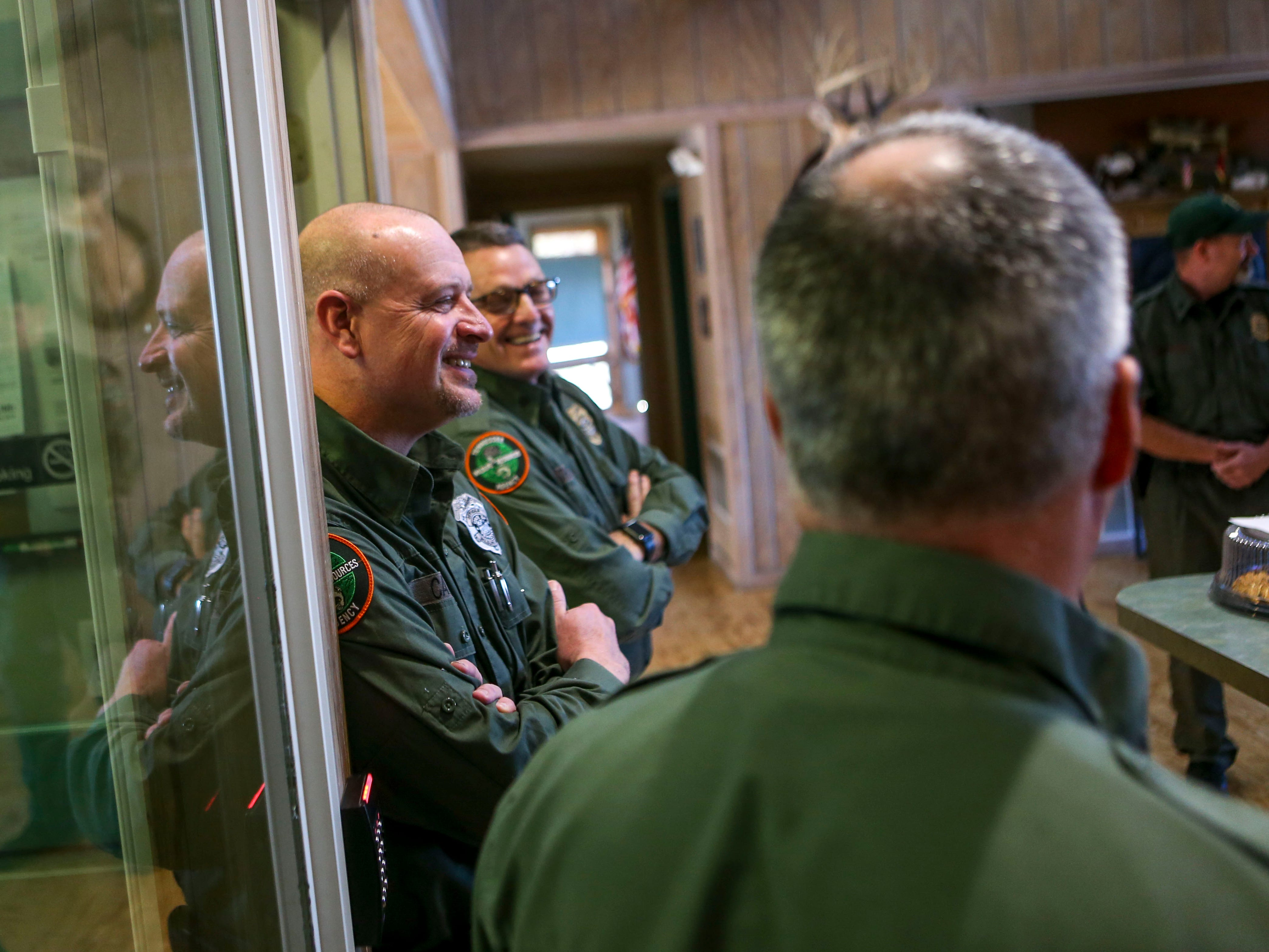 Wildlife Officer Chuck Casey smiles while joking around with others during a visit from supporters on National Law Enforcement Day at the Tennessee Wildlife Resource Agency Region One offices in Jackson, Tenn., on Wednesday, Jan. 9, 2019.