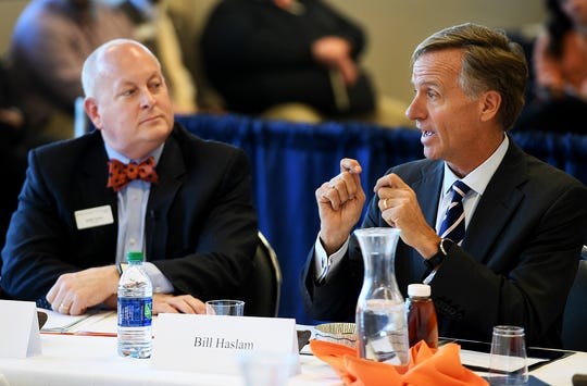 University of Tennessee Martin Chancellor Keith Carver, left, listens to Gov. Bill Haslam at a board meeting.