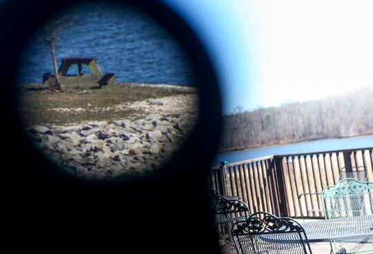 A spotting telescope points to an edge of Lake Graham at the Tennessee Wildlife Resource Agency Region One offices in Jackson, Tenn., on Wednesday, Jan. 9, 2019.