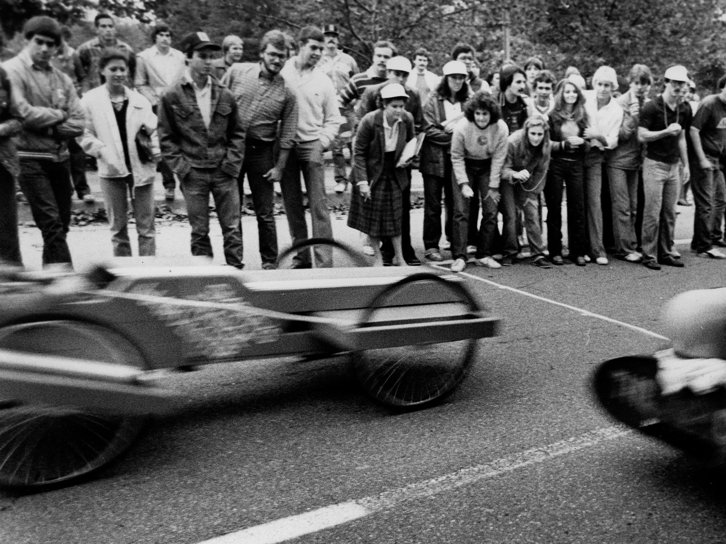 """Steve Cox in """"The Cob"""" crosss the finish line in a blur during homecoming activities at UTK Oct. 29, 1980."""