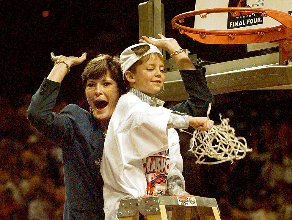 Pat and Tyler Summit horse around for the crowd after cutting the net down from the gaol after the Lady Vols won the National Championship 1998.