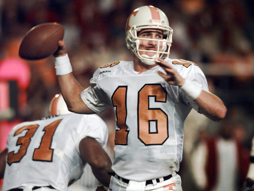 Tennessee quarterback Peyton Manning looks for a receiver during the Vols' 38-21 victory over Alabama Saturday, Oct. 19, 1997, in Birmingham. Manning had his sixth straight 300-yard game and became first SEC quarterback to beat Alabama three times.