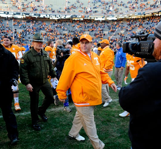 Tennessee interim head coach Jim Chaney walks off the field with a 1-0 record as Tennessee coach after their win over Kentucky at Neyland Stadium Saturday, Nov. 24, 2012.