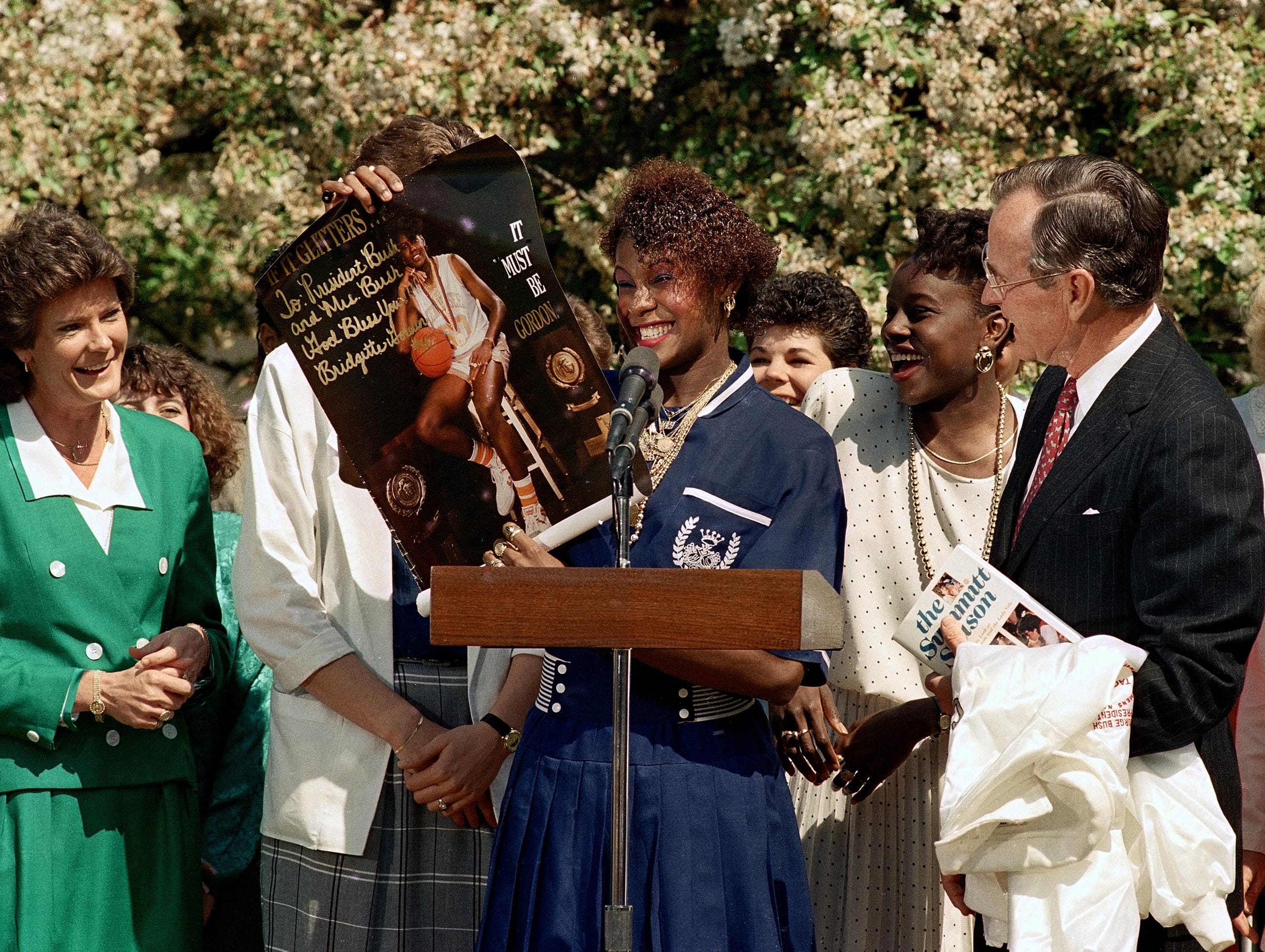 Lady Vol Bridgette Gordon presents President George Bush with a poster during a celebration of Tennessee's NCAA national championship on April 20, 1989 at the White House. At left is Coach Pat Summitt.