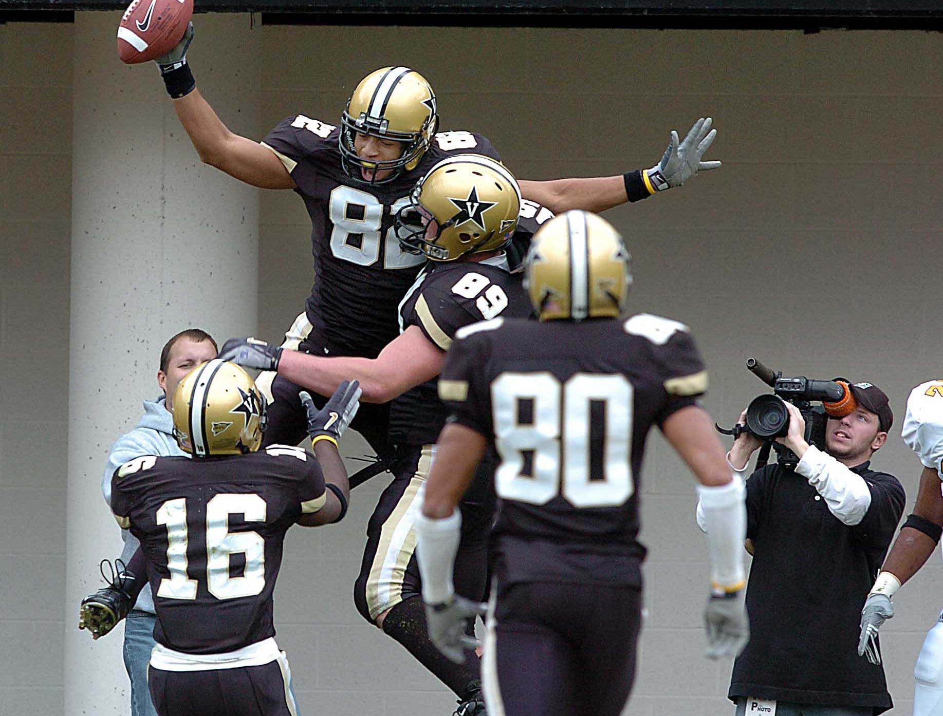 Vandy players celebrate after scoring their first touchdown againat Tennessee Saturday, Nov. 20, 2004 in Nashville.  Vandy's (82) Brad Allen scored and celebrates with (89) Jonathan Loyte and (16) Chris Young.