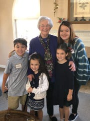 Mary Van Beke, who turned 102 Jan. 4, 2019, celebrated at a luncheon Jan. 5 with her son, Charles, and about 50 of her friends and relatives at the clubhouse at The Clusters at Greywood Crossing. Pictured with Mary are four of her great-grandchildren, Andrew Williams, Charlotte and Anna Van Beke, and Katherine Williams.
