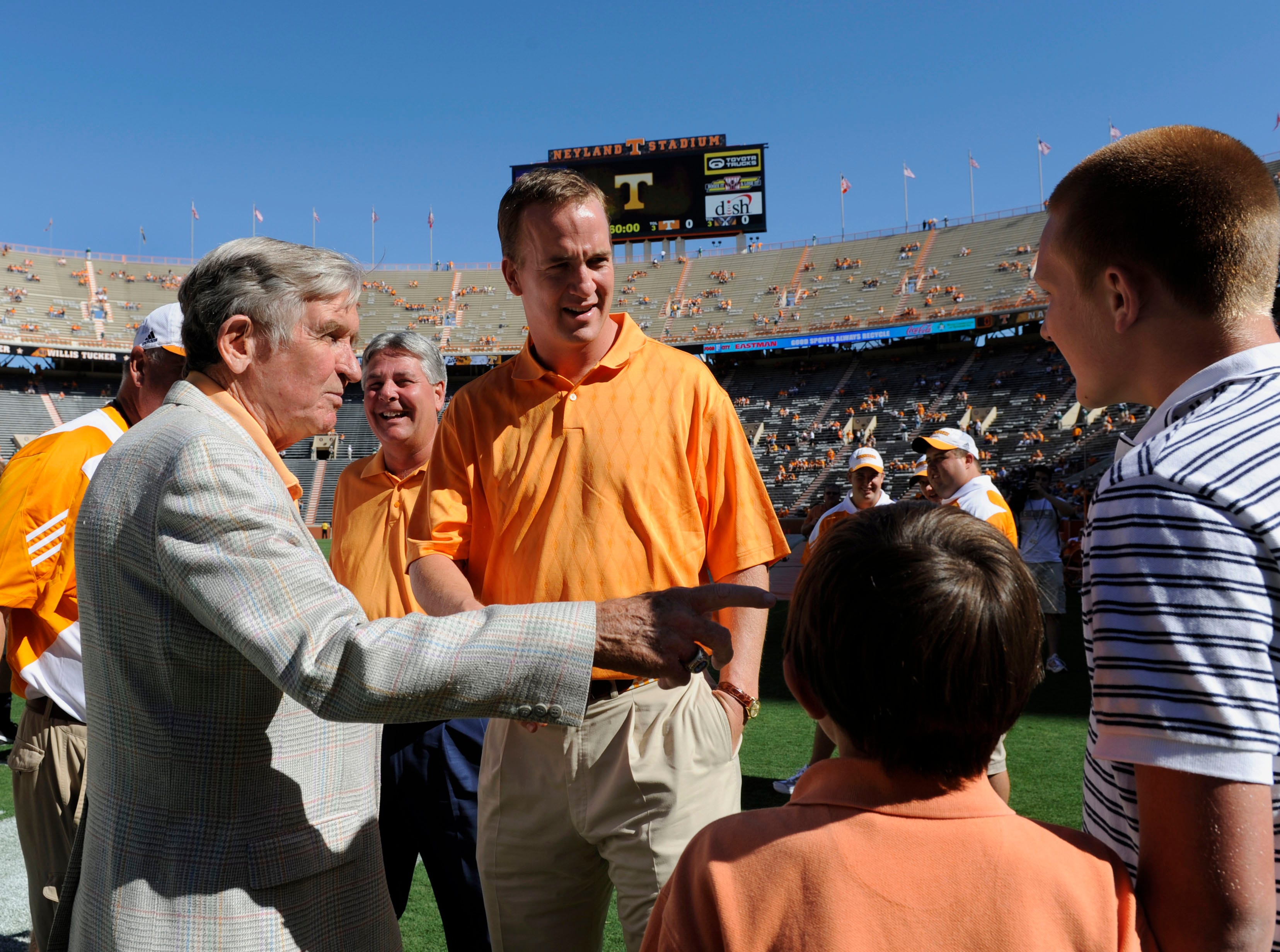 Former Tennessee coach Johnny Majors introduces his grandsons Owen, 10, and Tristan, 14, to Peyton Manning before the start of the UT-Martin game Saturday, Sept. 4, 2010, at Neyland Stadium.
