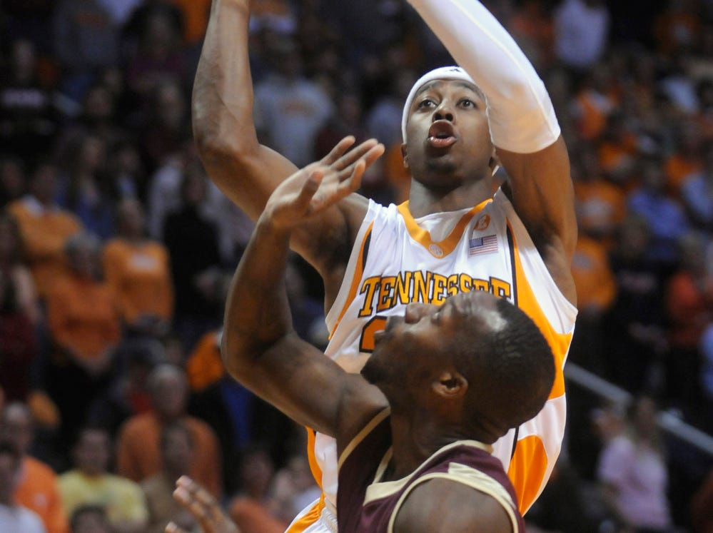Tennessee guard Scotty Hopson (top) shoots over College of Charleston forward Matt Sundberg (front) in the first half of an NCAA college basketball game in Knoxville, Tenn., Sat., Nov.  27, 2009.