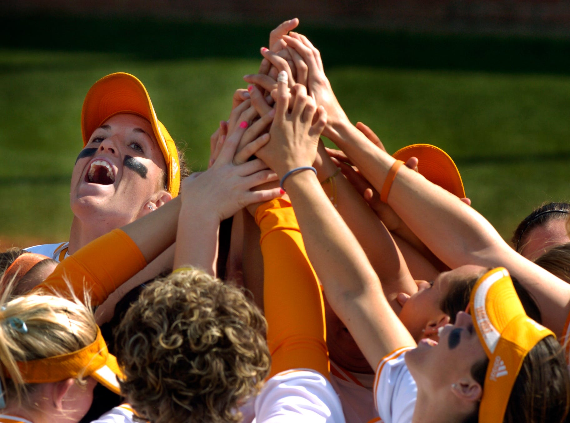 Monica Abbott, top left, and the Lady Vols celebrate in a huddle between innings during their 8-0 victory over the Furman Lady Paladins in the 2007 NCAA Regionals Friday night at Tyson Park.