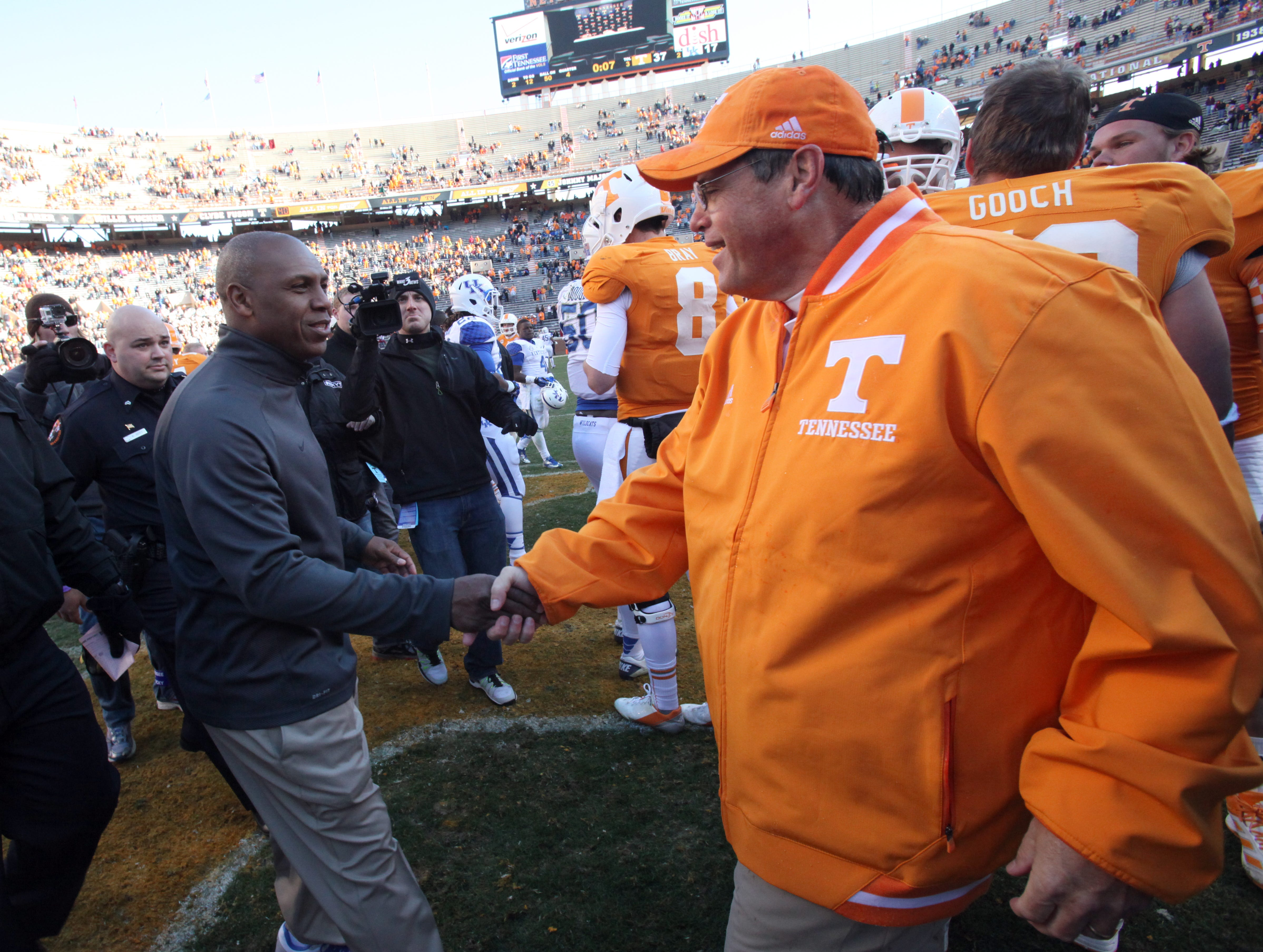 Tennessee interim head coach Jim Chaney, right, shakes hands with Kentucky head coach Joker Phillips, left, after the Vols defeated the Wildcats 37-17 at Neyland Stadium Saturday, Nov. 24, 2012.