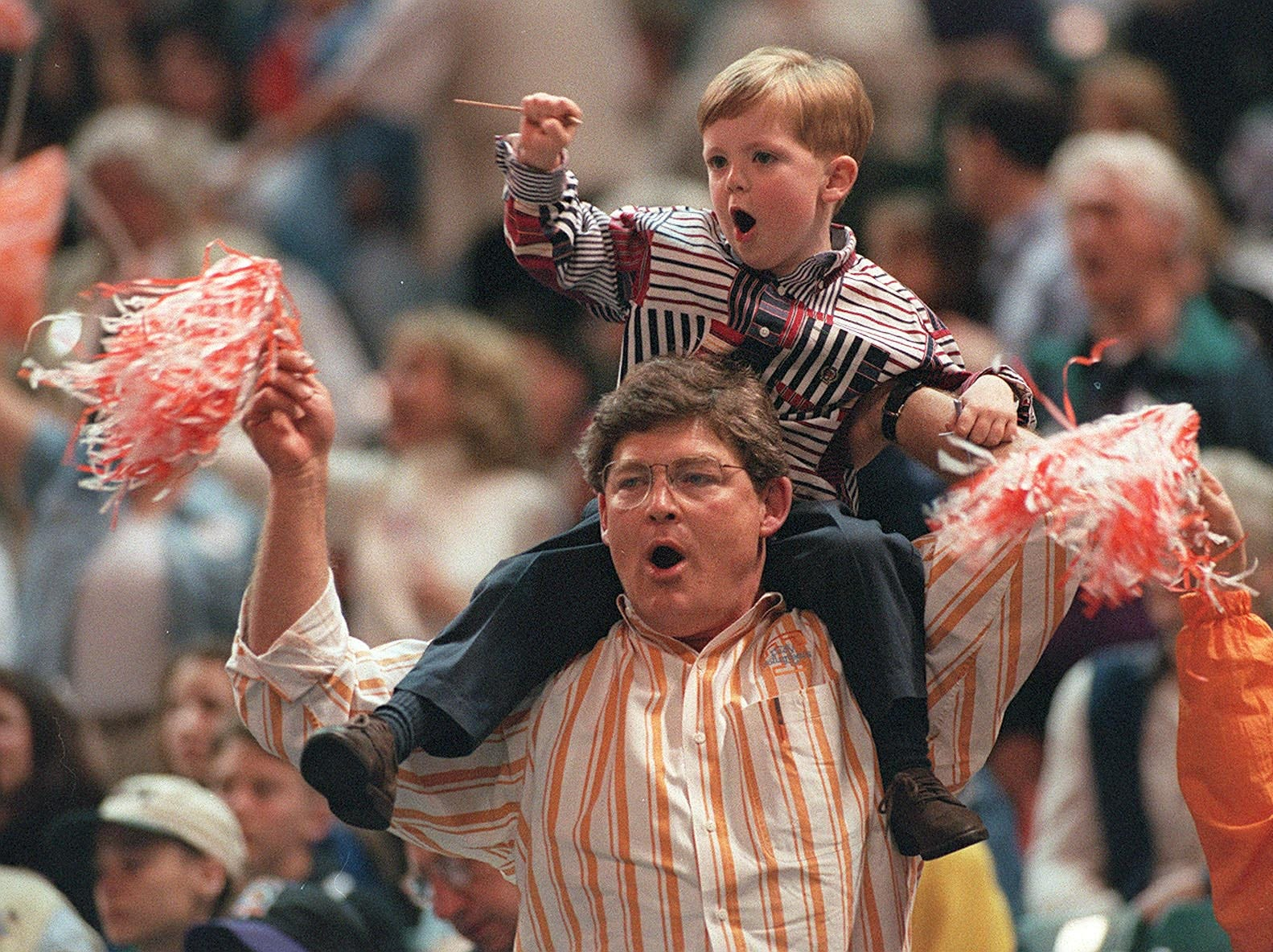 R.B. and Tyler Summitt cheer for the Lady Vols during the Final Four in Charlotte, NC. 1996.