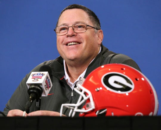 Georgia's offensive coordinator Jim Chaney takes questions during a news conference for the Sugar Bowl NCAA college football game against Texas on Sunday, Dec 30, 2018, in New Orleans.