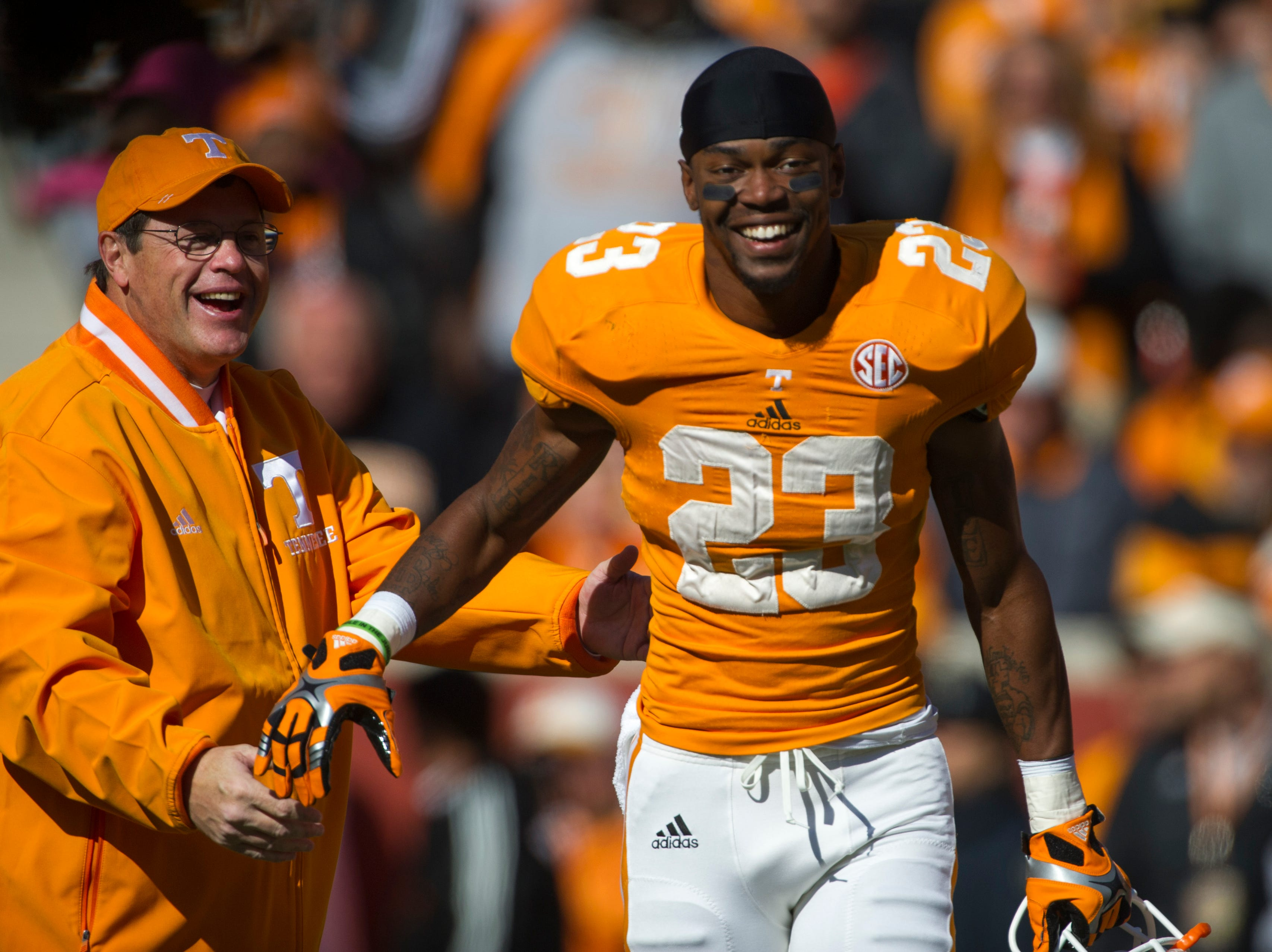 "Tennessee defensive back Prentiss Waggner (23) is congratulated by interim head coach Jim Chaney as he runs through the ""T"" one last time before the game against Kentucky at Neyland Stadium Saturday, Nov. 24, 2012."
