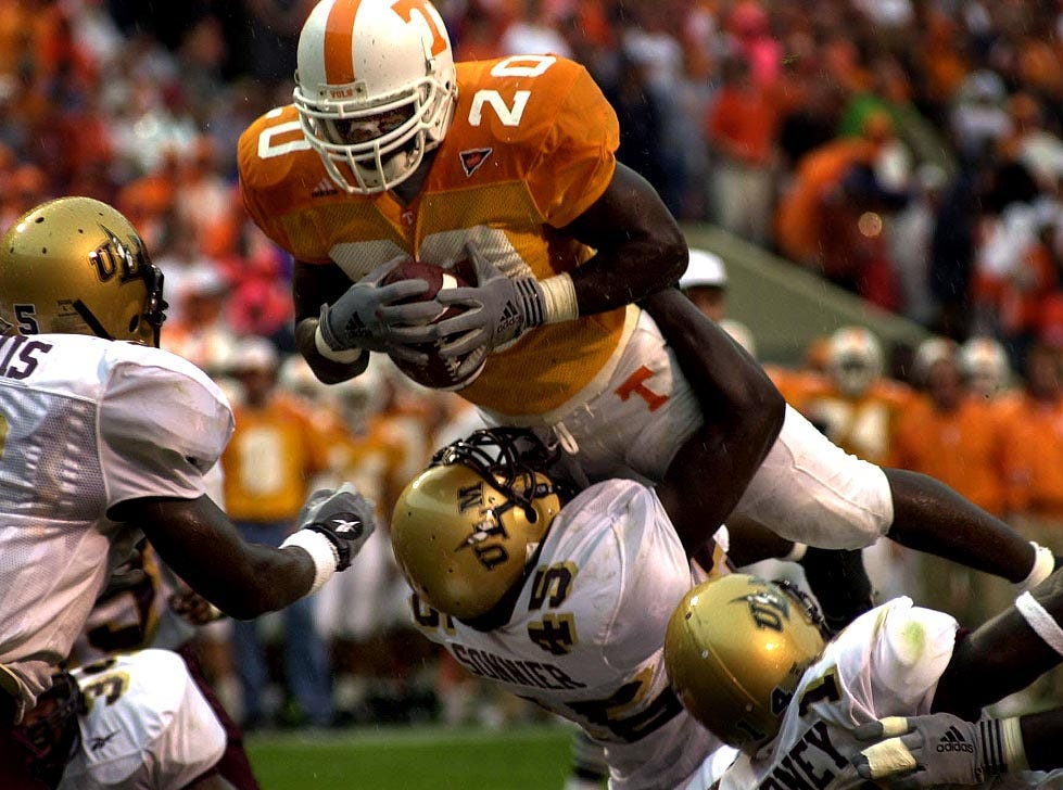Tennessee's Travis Henry dives over La Monroe's #45-Maurice Sonnier for the second of many touchdowns Saturday. 9/23/2000.
