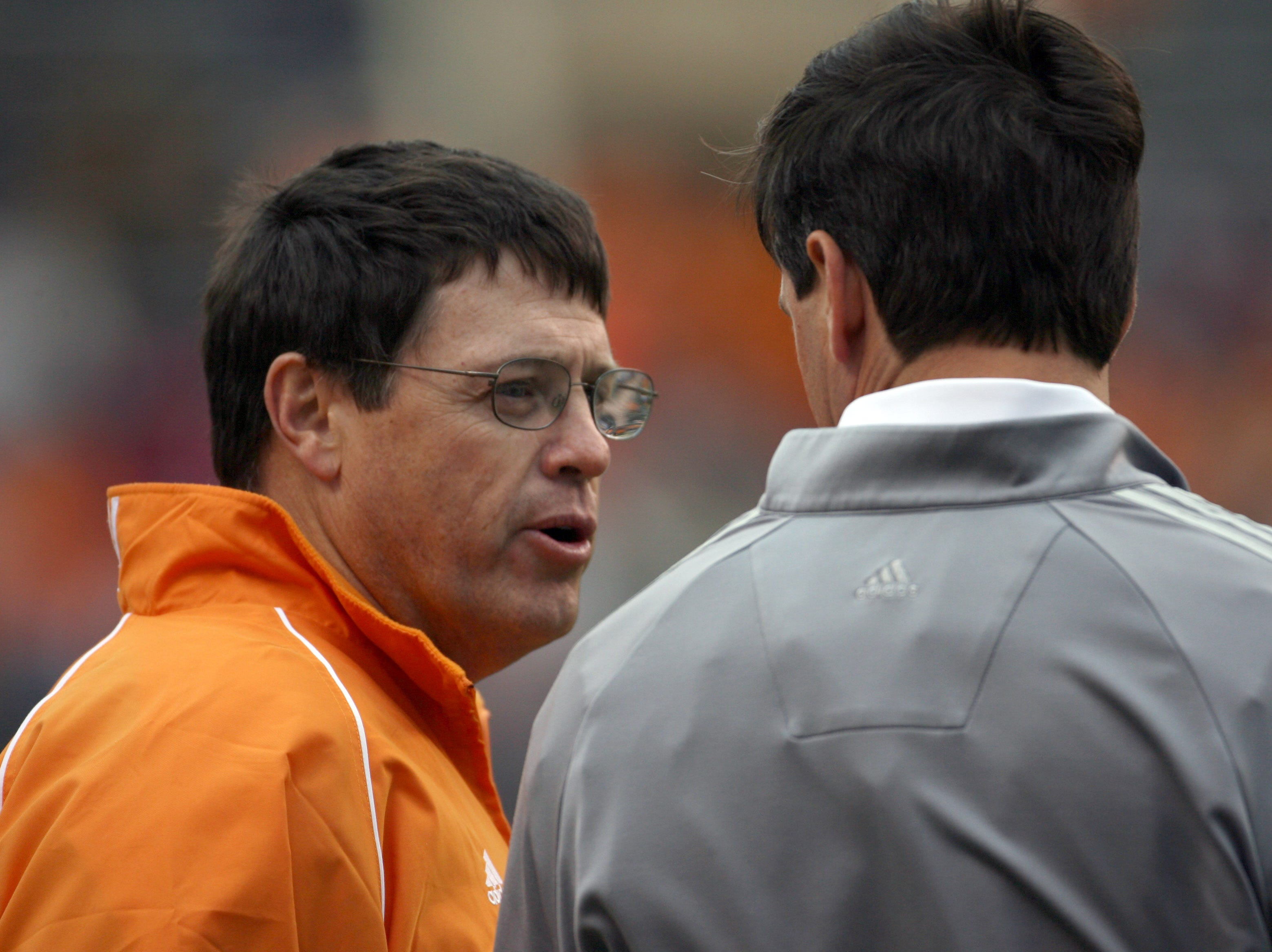 Tennessee offensive coordinator Jim Chaney, left, talks with head coach Derek Dooley during the Orange and White game at Neyland Stadium Saturday, April 16, 2011.  White won the game 24-7 over Orange.