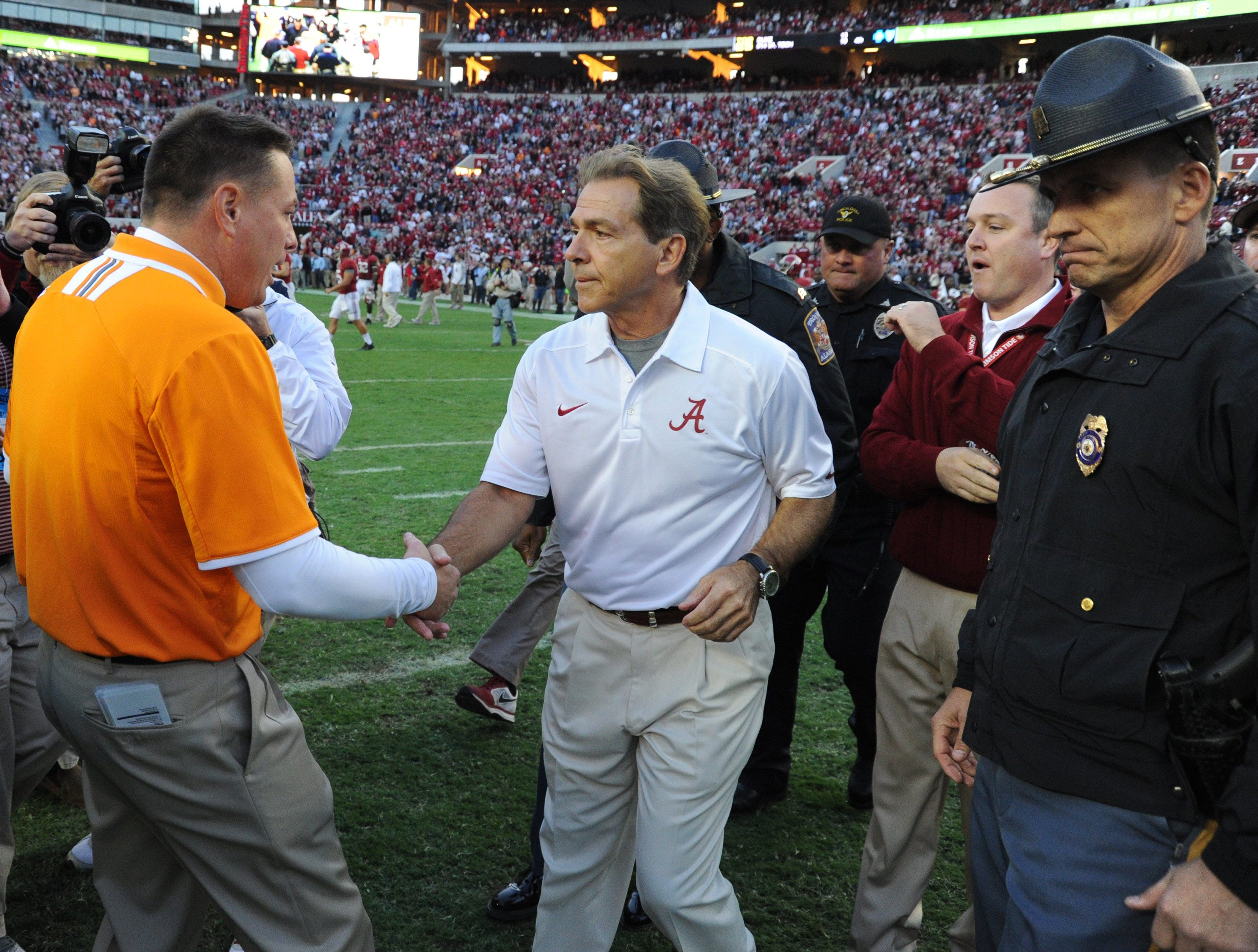 Alabama head coach Nick Saban and Tennessee head coach Butch Jones meet center field following their 45-10 victory over the Volunteers Saturday, Oct. 26, 2013 at Bryant-Denny Stadium in Tuscaloosa, Ala.
