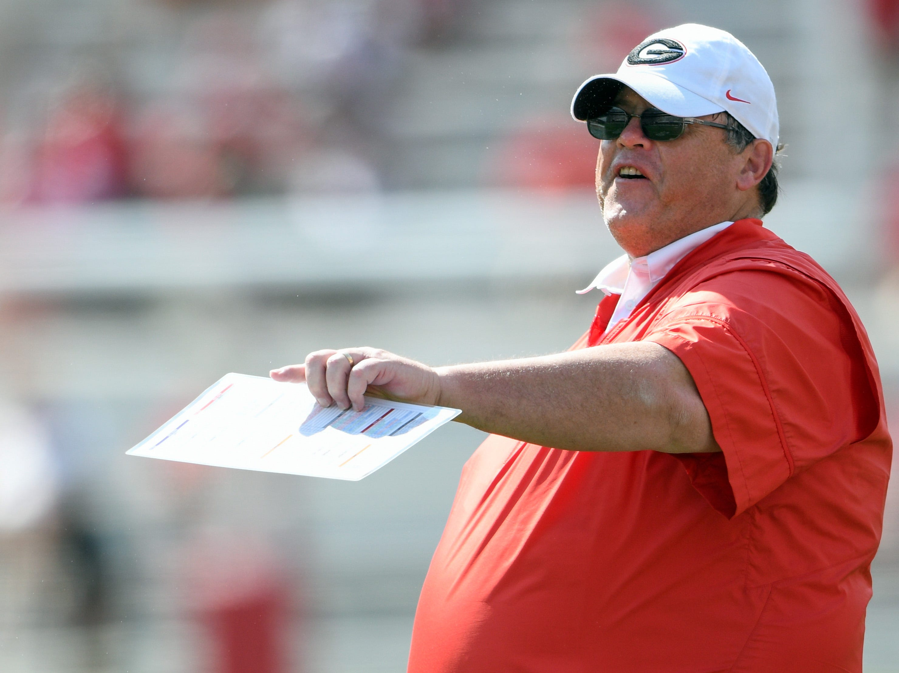 Apr 22, 2017; Athens, GA, USA; Georgia Bulldogs offensive coordinator Jim Chaney  reacts on the field during the second half during the Georgia Spring Game at Sanford Stadium. Red defeated Black 25-22.