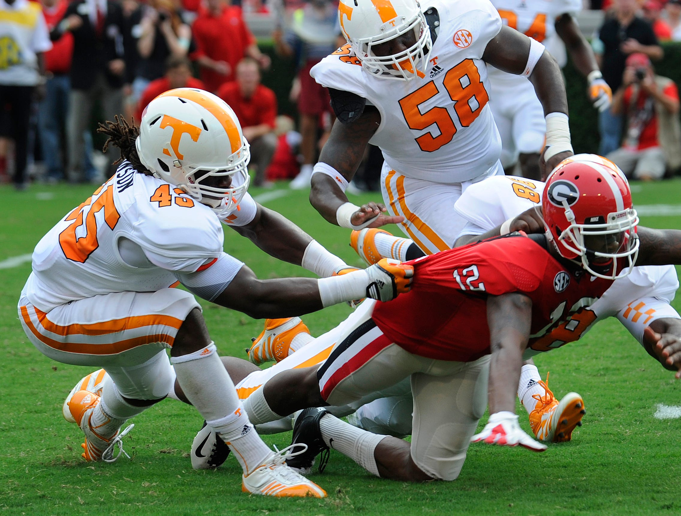 Not sure I've had a still frame that showed clearly that Bulldogs wide receiver Tavarres King's knee was down before the ball crossed the goal line. Tennessee linebacker A.J. Johnson (45) was able to stop him and after an official review the call on the field was revised and the touchdown taken back.