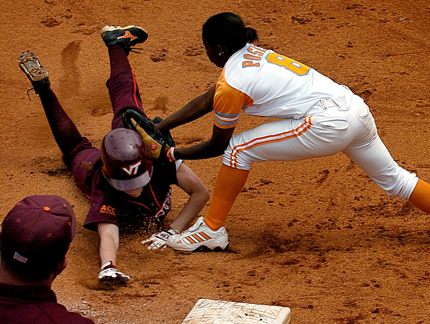 Lady Vols Kenora Posey (8) tags out Virginia Tech's Crystal Beach (17) before she can reach third base in the second inning Saturday. Tennessee beat the Virginia Tech Hokies 9-1 to advance in the regionals  at Tyson Park.