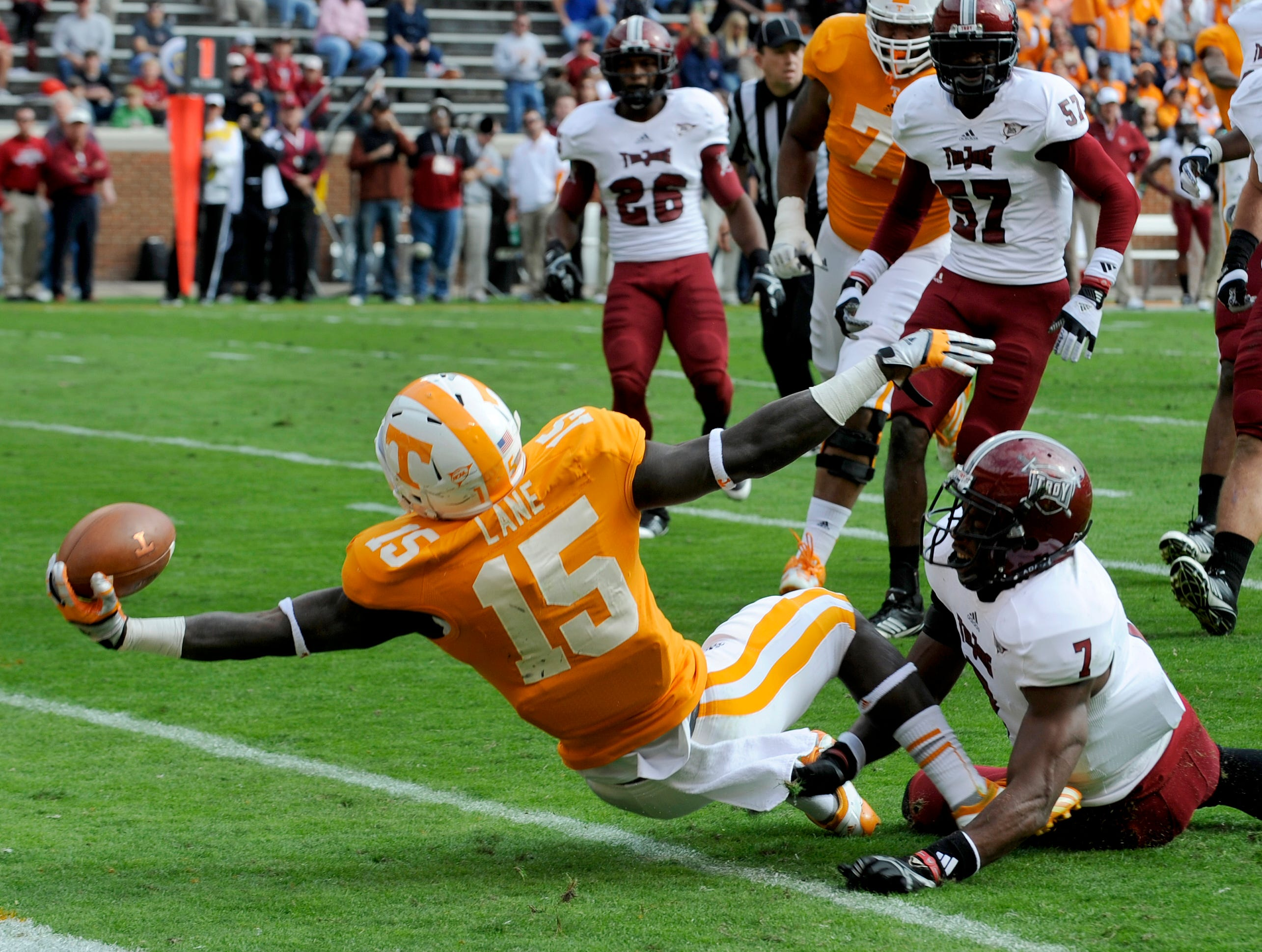 Tennessee running back Marlin Lane (15) pulls away from Troy's Chris Pickett to score a touchdown during the first half of their game Saturday, Nov. 3, 2012 in Neyland Stadium.