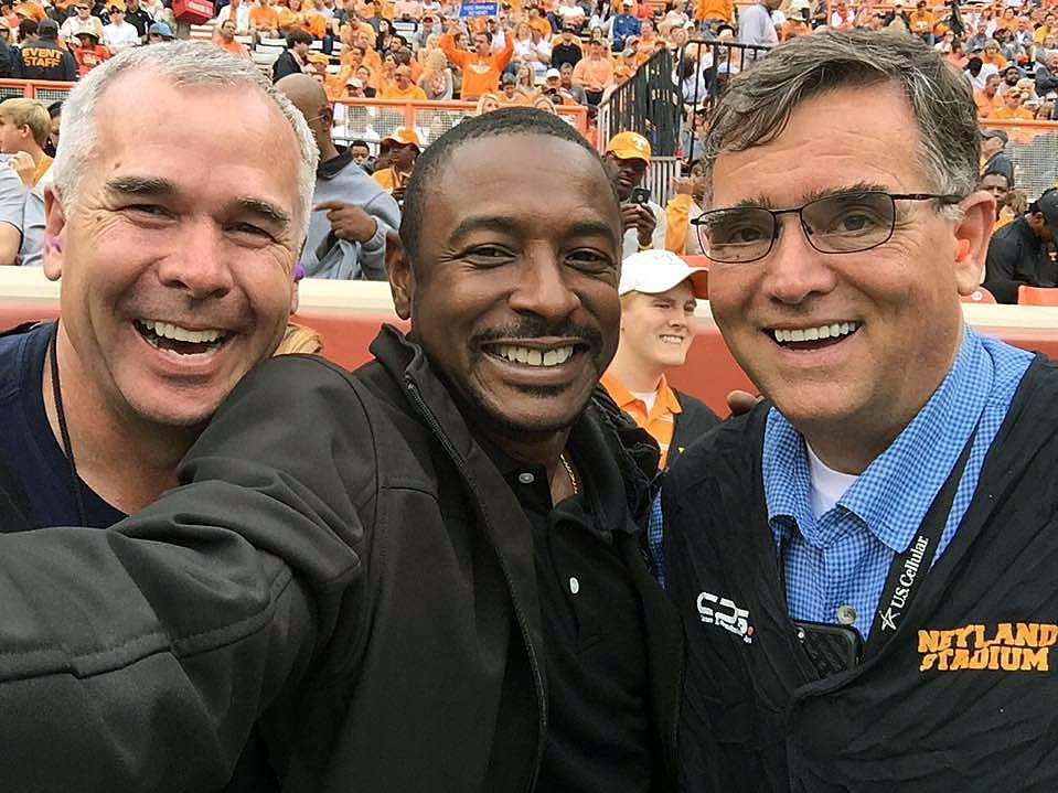 Sports photographers Larry McCormick, left, Byron Small, and Michel Patrick have become friends partly from covering UT football games together for years.