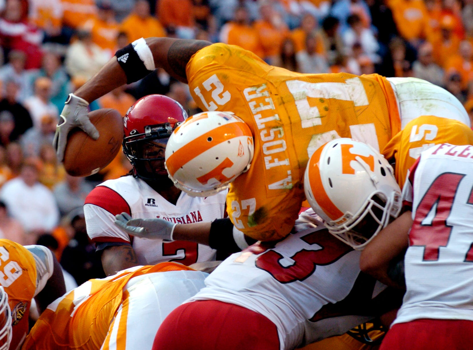 Tennessee's Arian Foster dives over the top of the line for a 1-yard touchdown against Louisiana-Lafayette on Saturday at Neyland Stadium. The Vols celebrated homecoming by crushing the Ragin' Cajuns 59-7, improving to 6-3 for the season.
