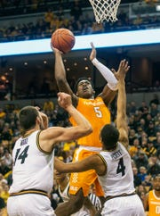 Tennessee's Admiral Schofield, top, shoots over Missouri's Reed Nikko, left, and Javon Pickett during the first half of an NCAA college basketball game Tuesday, Jan. 8, 2019, in Columbia, Mo. (AP Photo/L.G. Patterson)