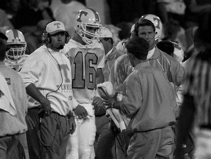 Tennessee quarterback Peyton Manning talks to QB and head coach Phillip Fulmer during Georgia game Oct. 12, 1996.