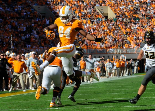 Tennessee wide receiver Cordarrelle Patterson (84) leaps over the goal line to score a touchdown during the first half against Missouri at Neyland Stadium Saturday, Nov. 10, 2012.